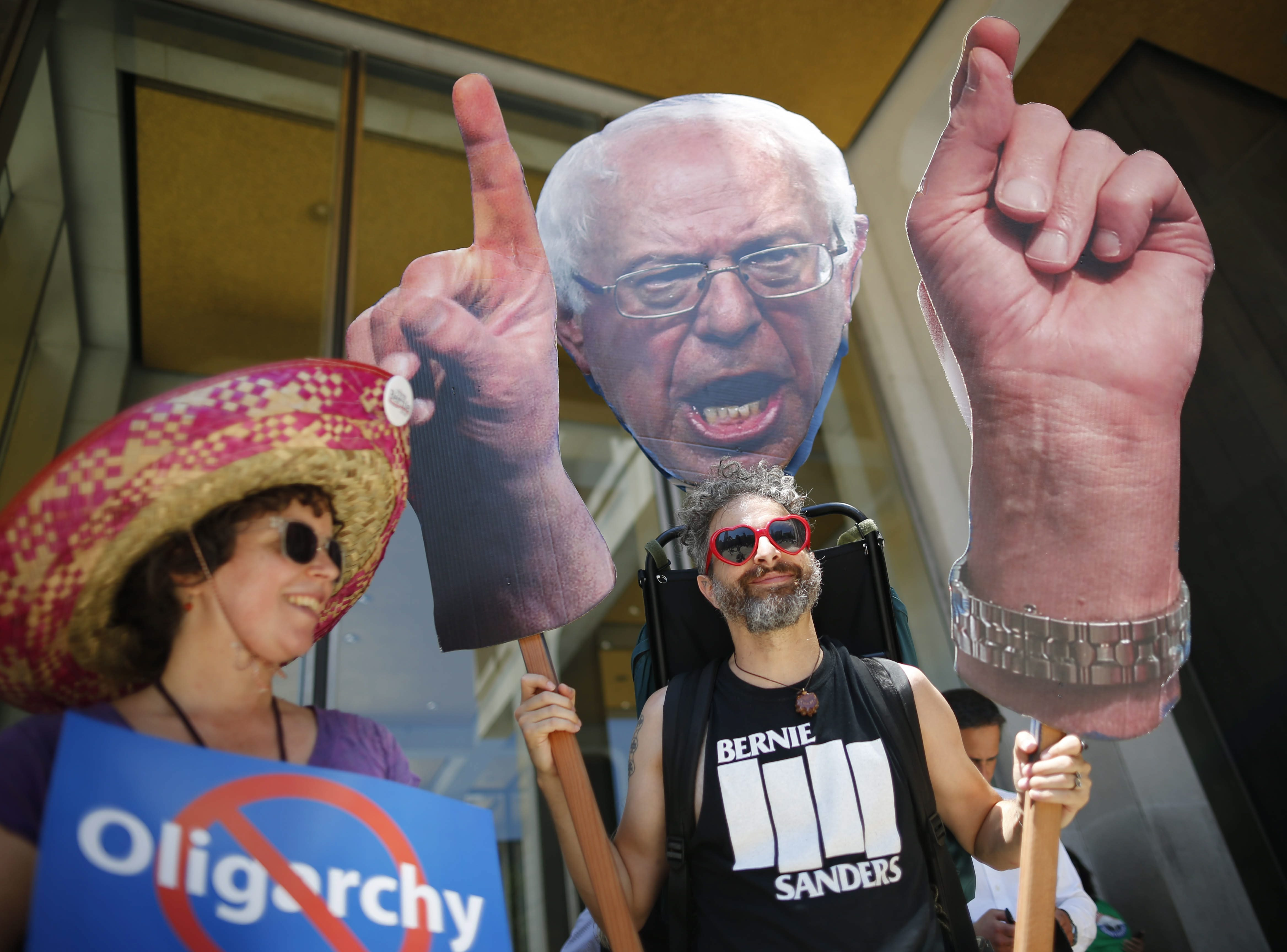 A protester outside the Democratic National Convention carries a larger-than-life Bernie Sanders puppet during a rally in Philadelphia on July 27  (Derek Gee/Buffalo News)