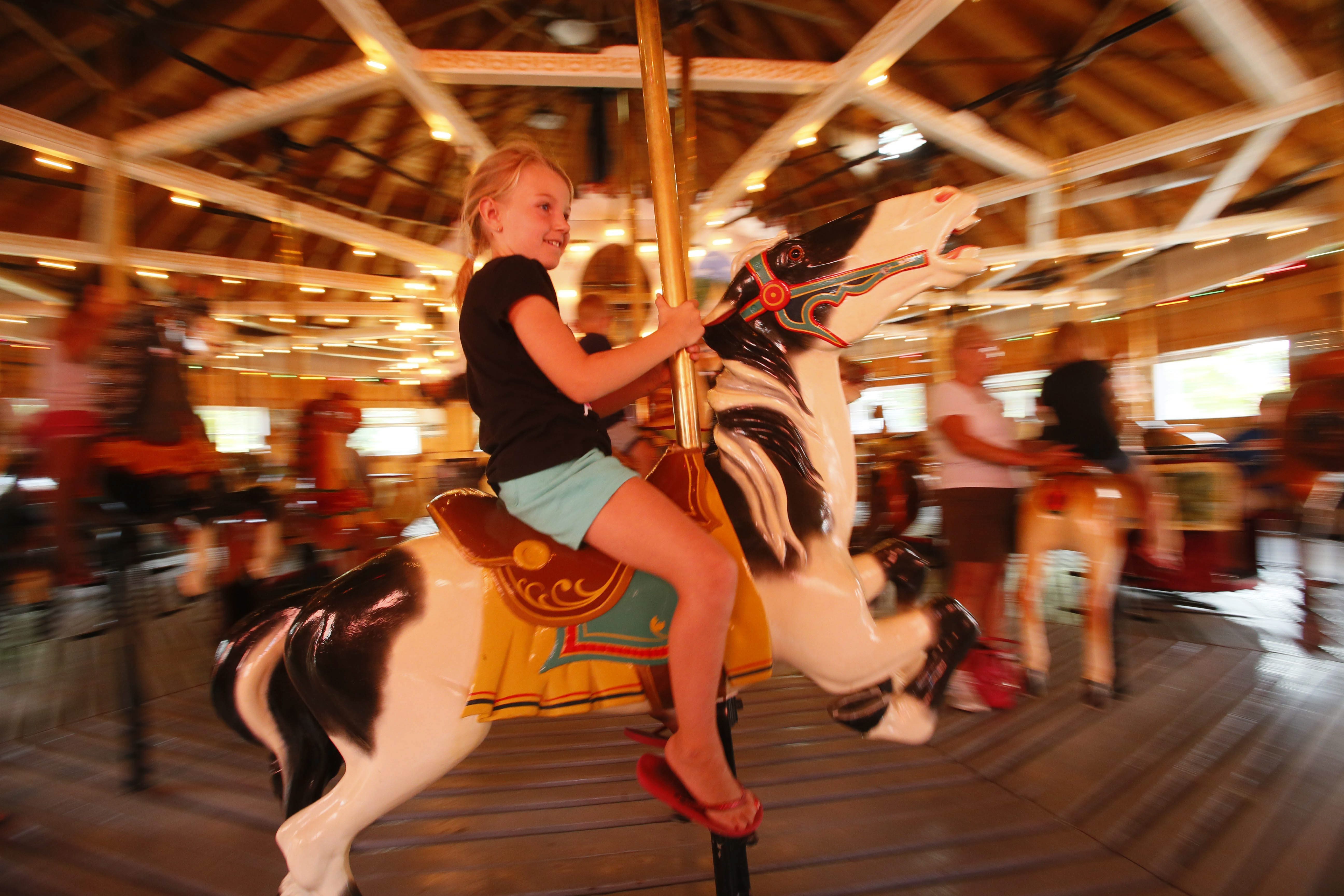 Madison Warthling goes for a ride at the Herschell Carrousel Factory Museum in North Tonawanda. (Derek Gee/Buffalo News)