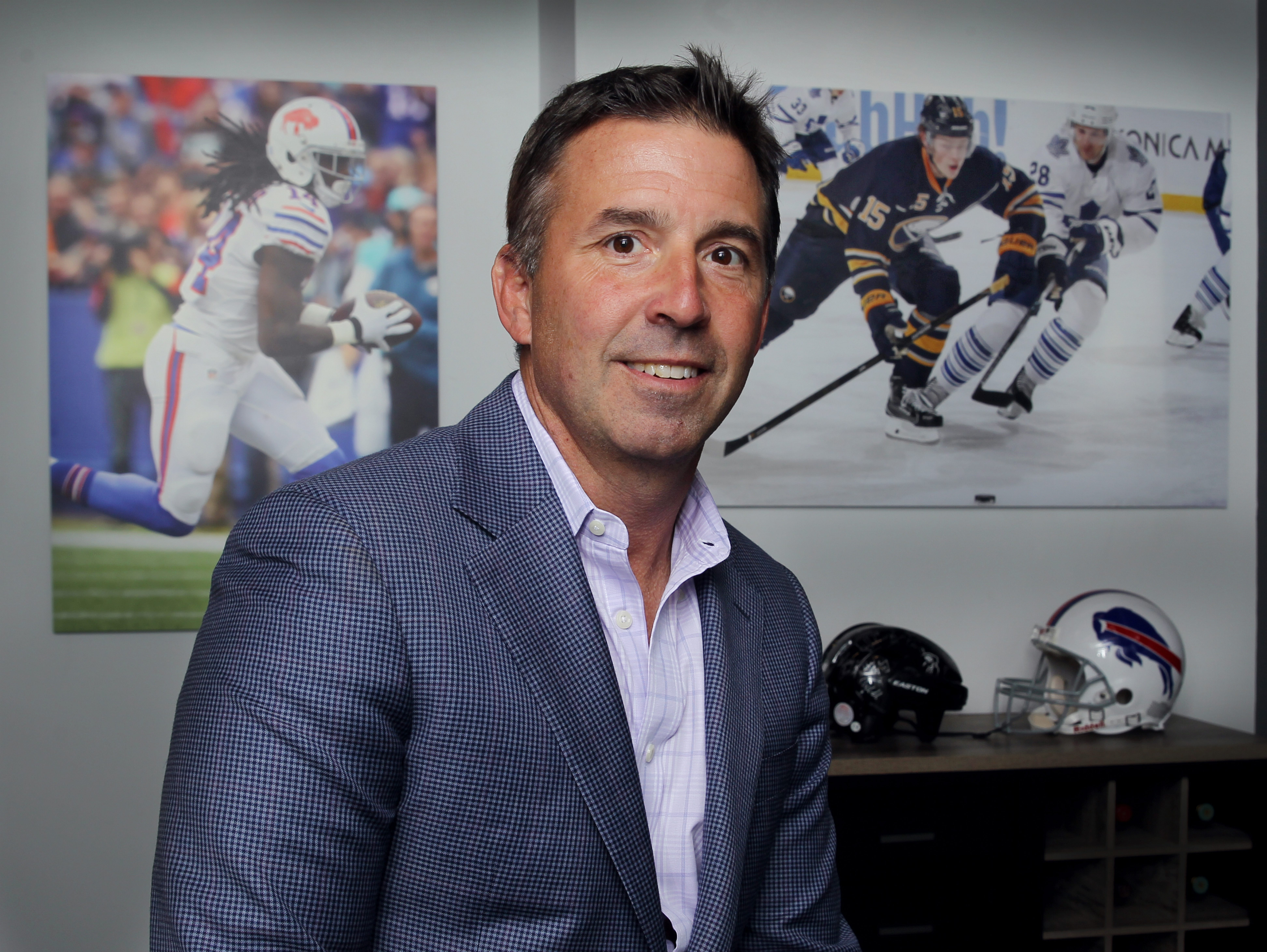 Russ Brandon's office has photos of two of Buffalo's biggest sports stars, the Bills' Sammy Watkins and the Sabres' Jack Eichel. (James P. McCoy/Buffalo News)