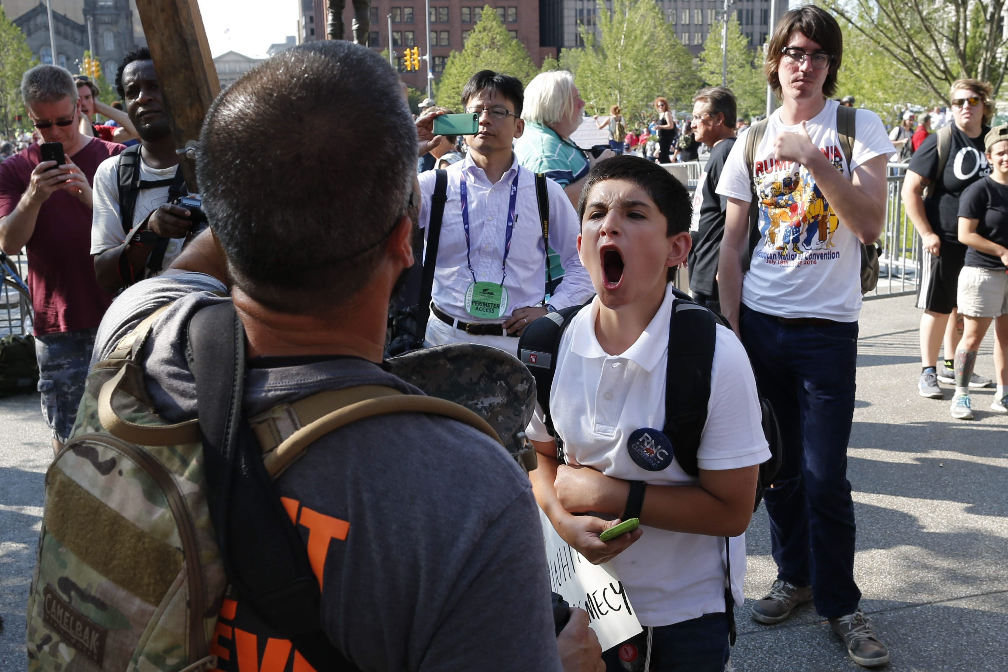 Ranan Steiger, 16, of Cleveland, gets in the face of a Christian protestor in Cleveland's Public Square on July 19. (Derek Gee/Buffalo News)