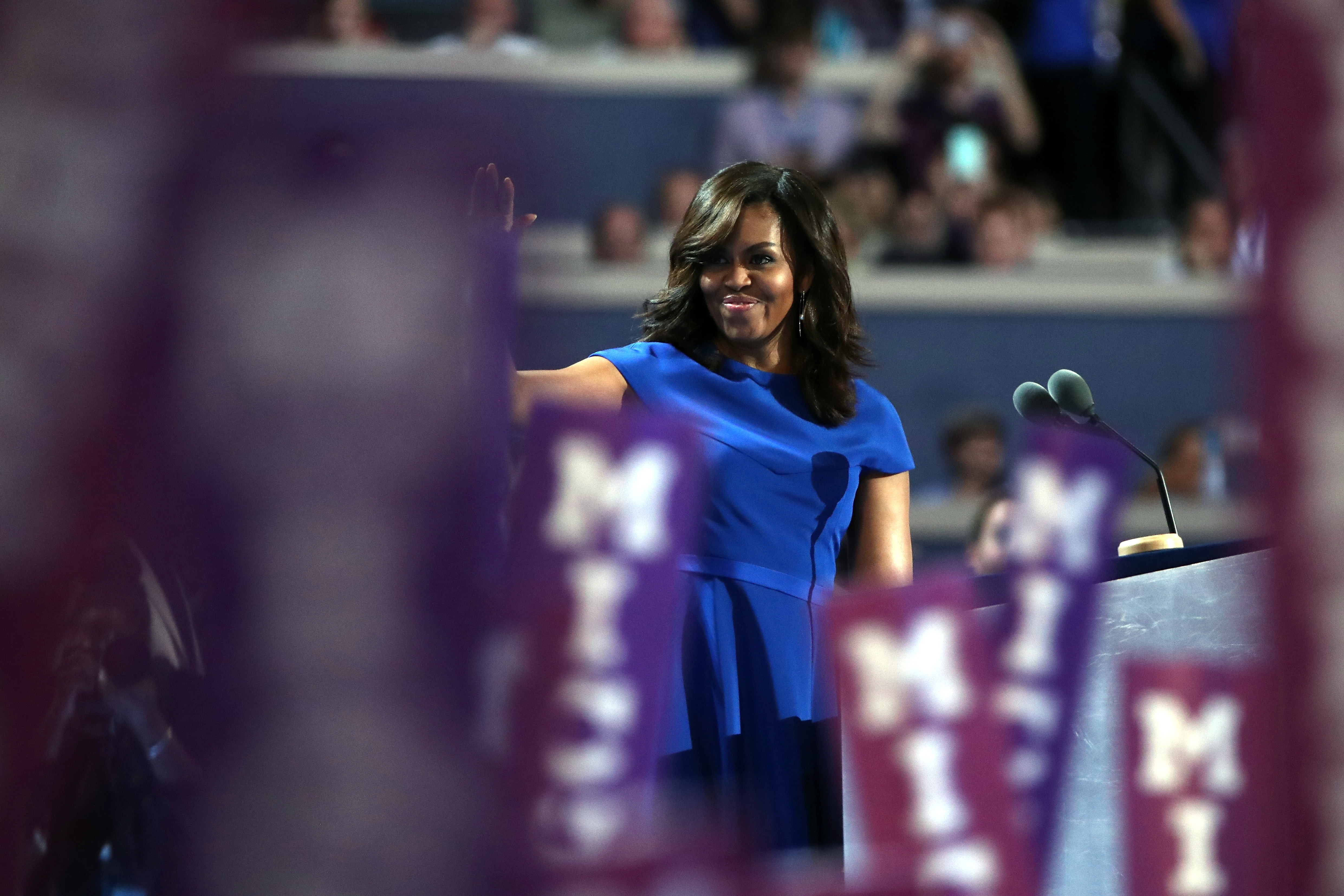 First lady Michelle Obama waves to the crowd before speaking to the Democratic National Convention. She offered strong takedown of Trump and heartfelt endorsement of Clinton.