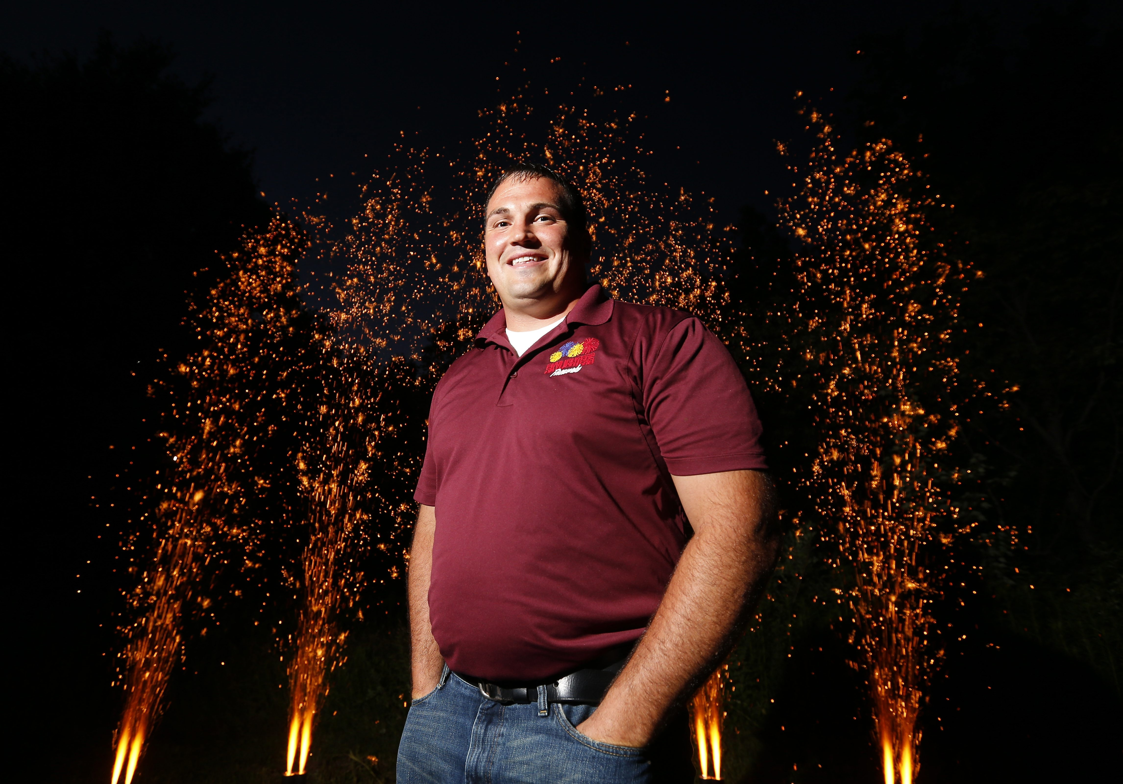 Skylighters Fireworks owner Matt Shaw in front of his display in Boston Wednesday. Shaw has worked at the company for 13 years total, eight as an employee and five as owner.