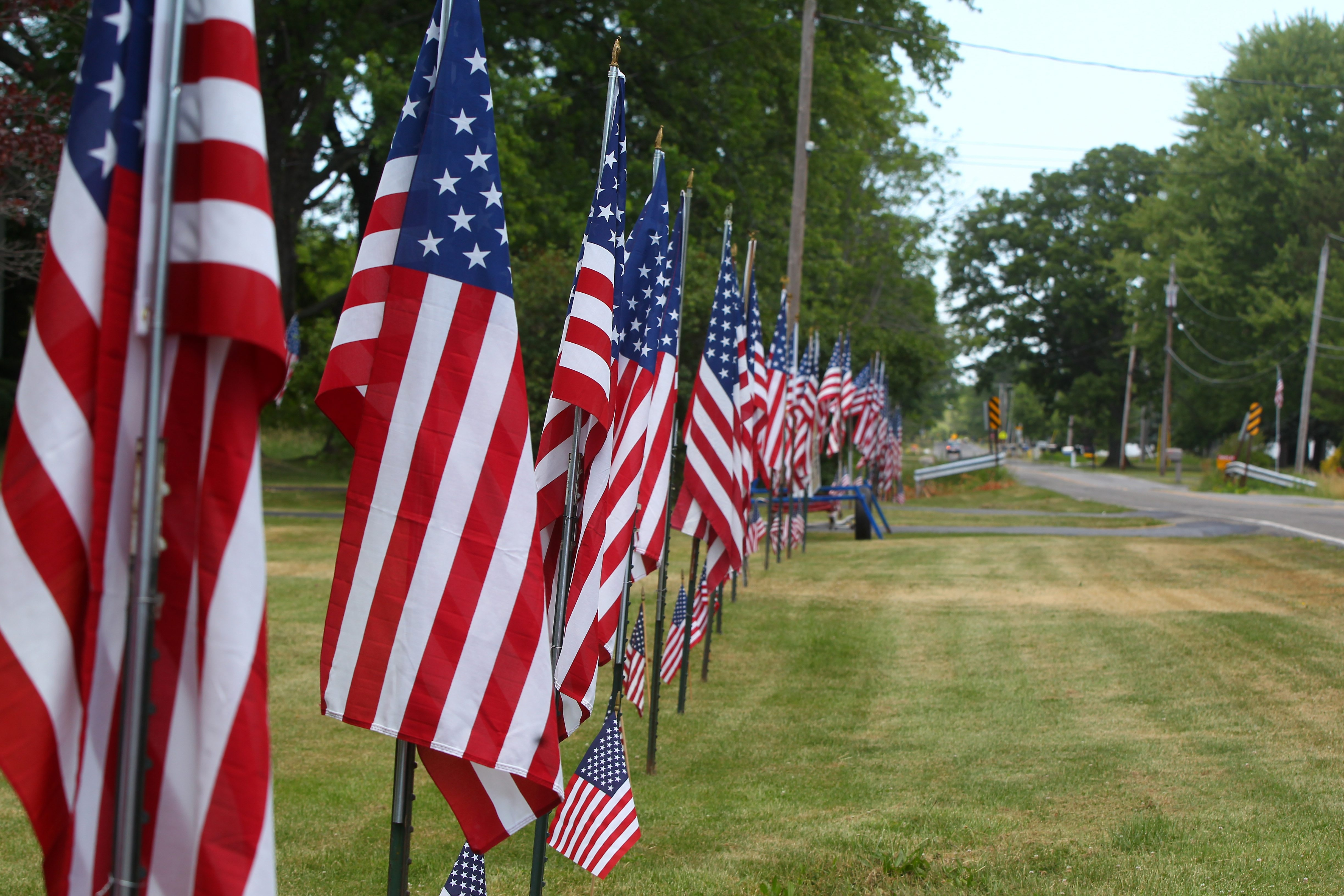 Flags line the road in front of Paul Greinert's farm on Errick Road in Wheatfield. The tradition began with the birth of a grandchild.