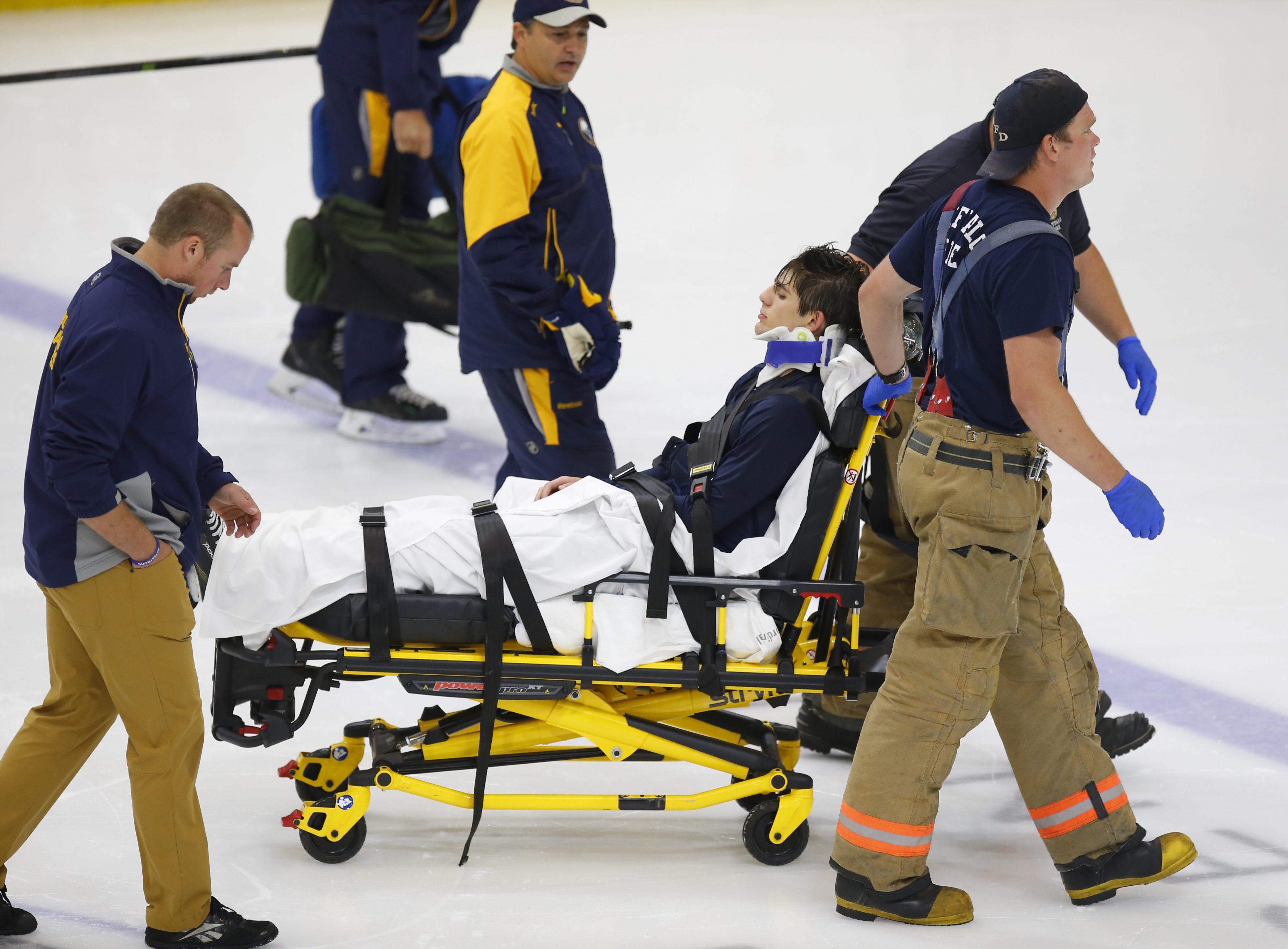 Sabres prospect Michael Campoli is taken off the ice on a stretcher after injuring his neck during the three-on-three tournament Tuesday.