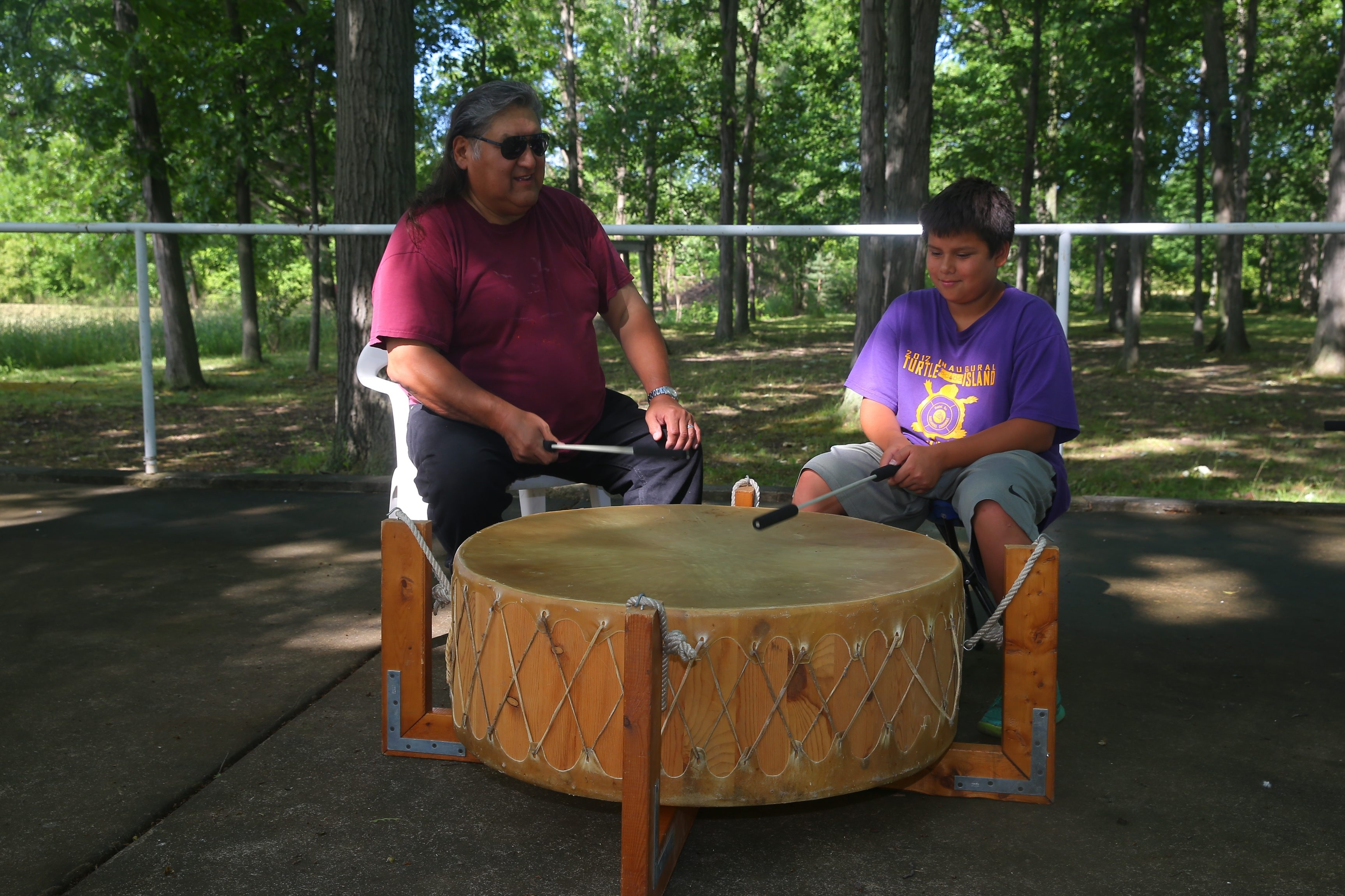 Neil Patterson, left, a Tuscarora Native from the Sand Turtle Clan, as been the organizer for more than 30 years of the Tuscarora Nation Picnic and Field Days. He is pictured with his grandson Alex Cowdy, 11, of the White Bear clan. (John Hickey/Buffalo News)