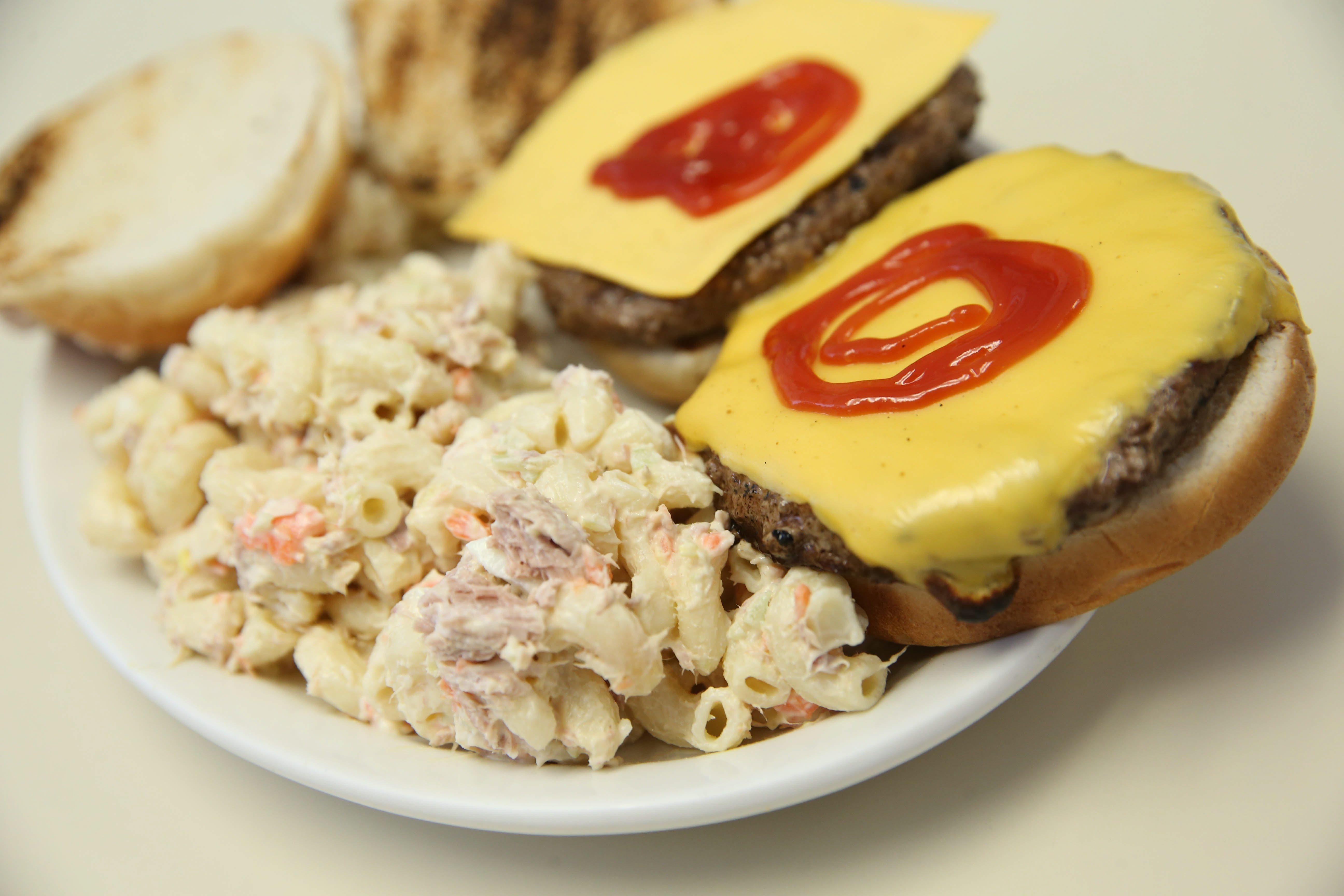 Summertime fare like cheeseburgers with housemade macaroni salad are a favorite at the Dog Shack.