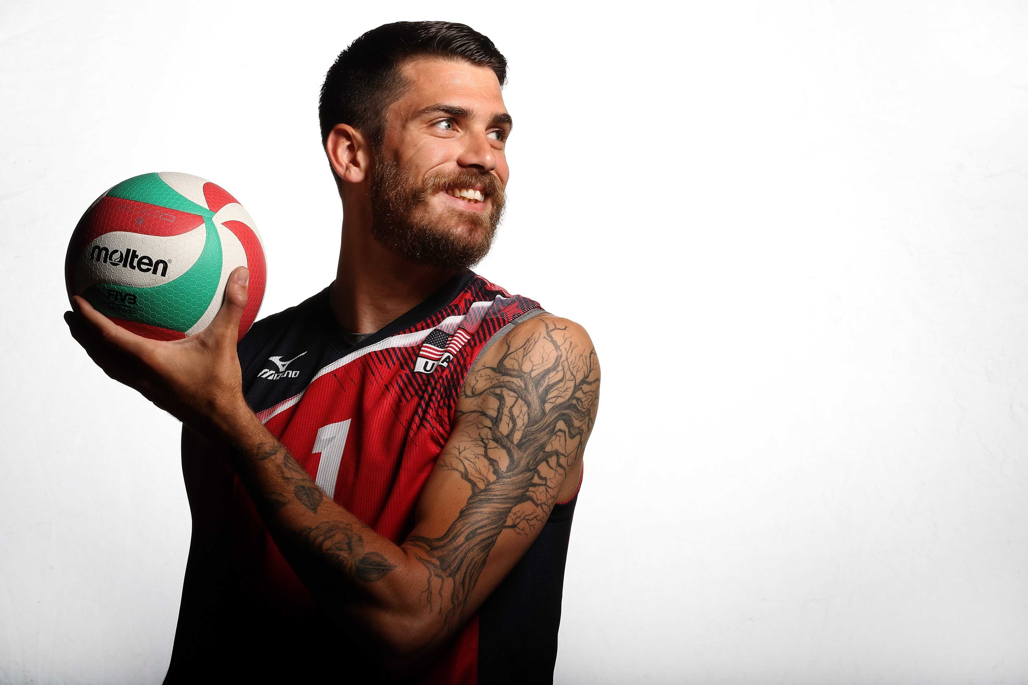 Matt Anderson's tattoo of a tree symbolizes his family roots and Buffalo background. He took a break from volleyball, then came back to take MVP honors in leading the U.S. to the 2015 World Cup title.