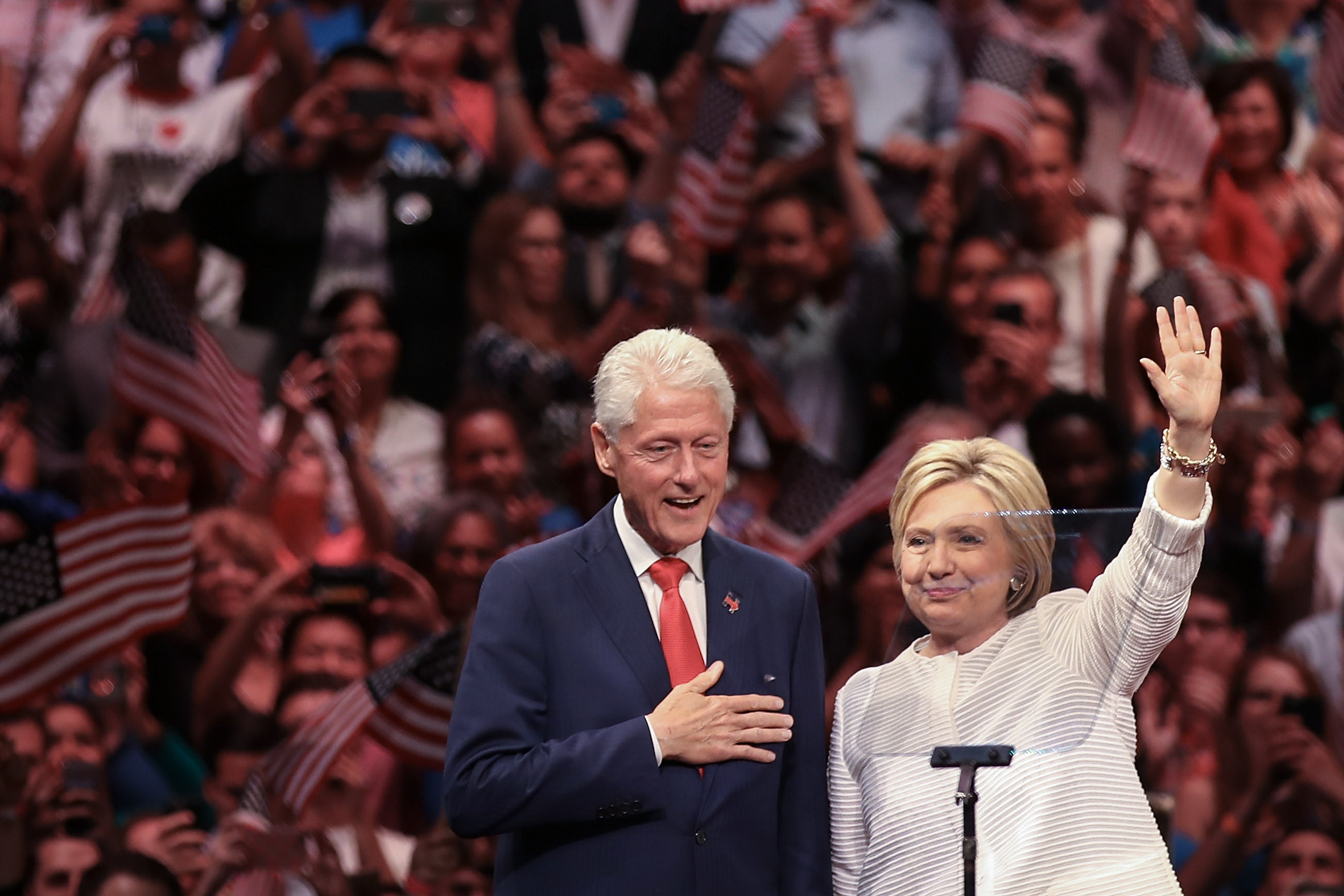 Husband and former president Bill Clinton and Democratic presidential candidate Hillary Clinton acknowledge the crowd during a primary night rally at the Duggal Greenhouse in the Brooklyn Navy Yard, June 7, 2016. (Getty Images)