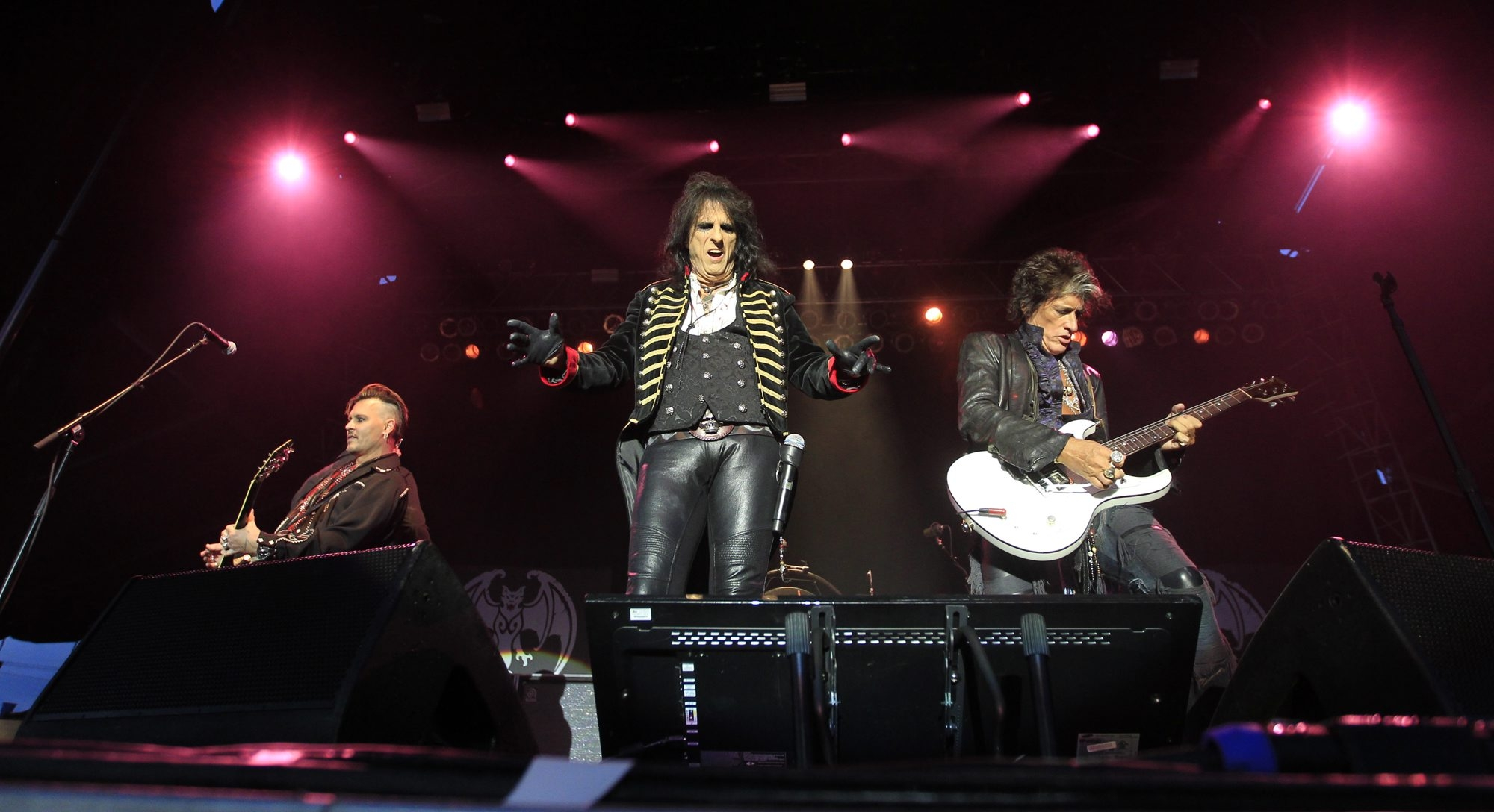 The Hollywood Vampires – from left, Johnny Depp, Alice Cooper and Joe Perry – command a menacing presence on a stage in the parking lot of Niagara Falls' Seneca Niagara Casino on Saturday night. The much-anticipated appearance by the musical amalgam of Hollywood and rock-and-roll was delayed a bit by rain.