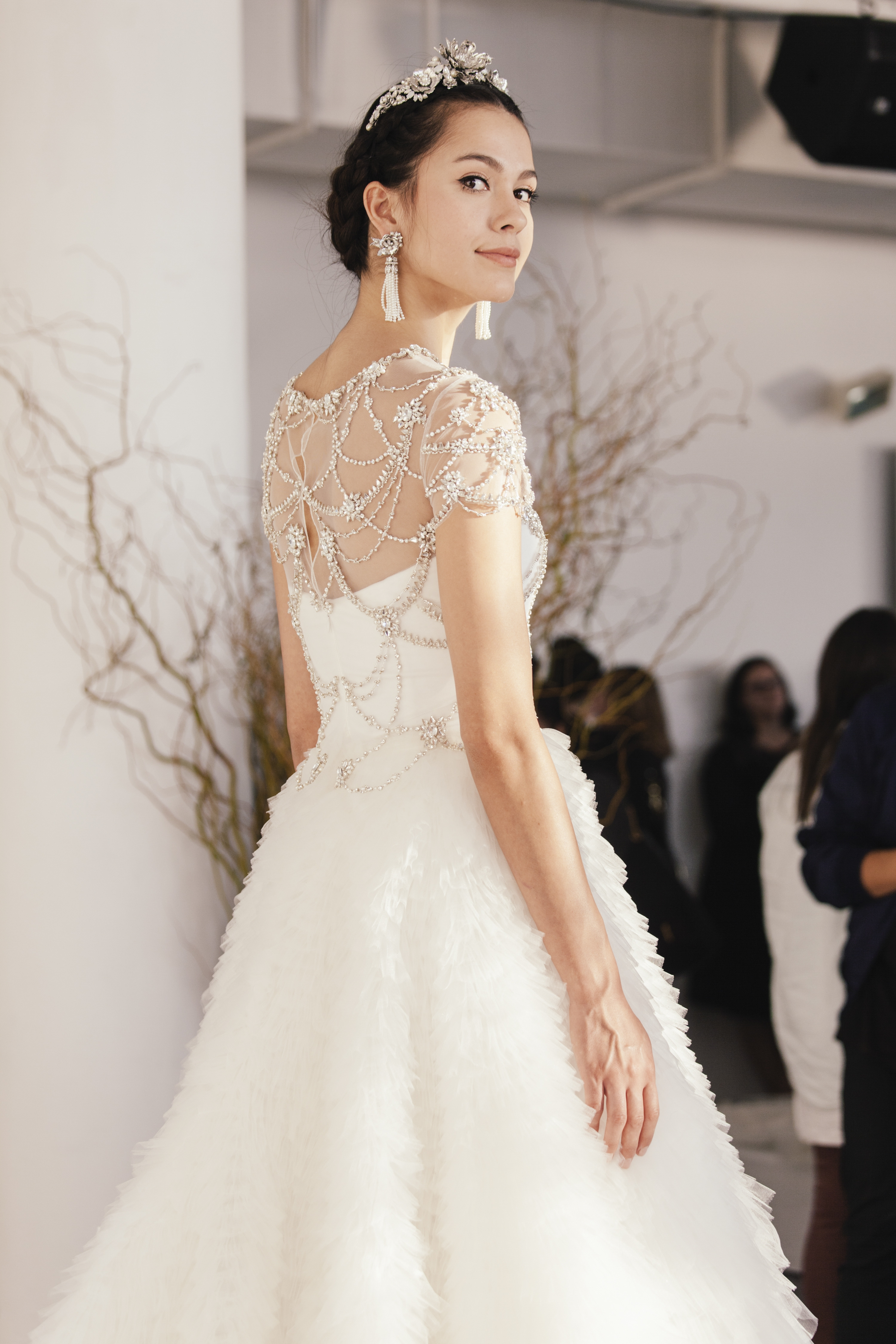 A model wears a cap-sleeve dress covered in faux gems during a bridal presentation in New York. (New York Times)