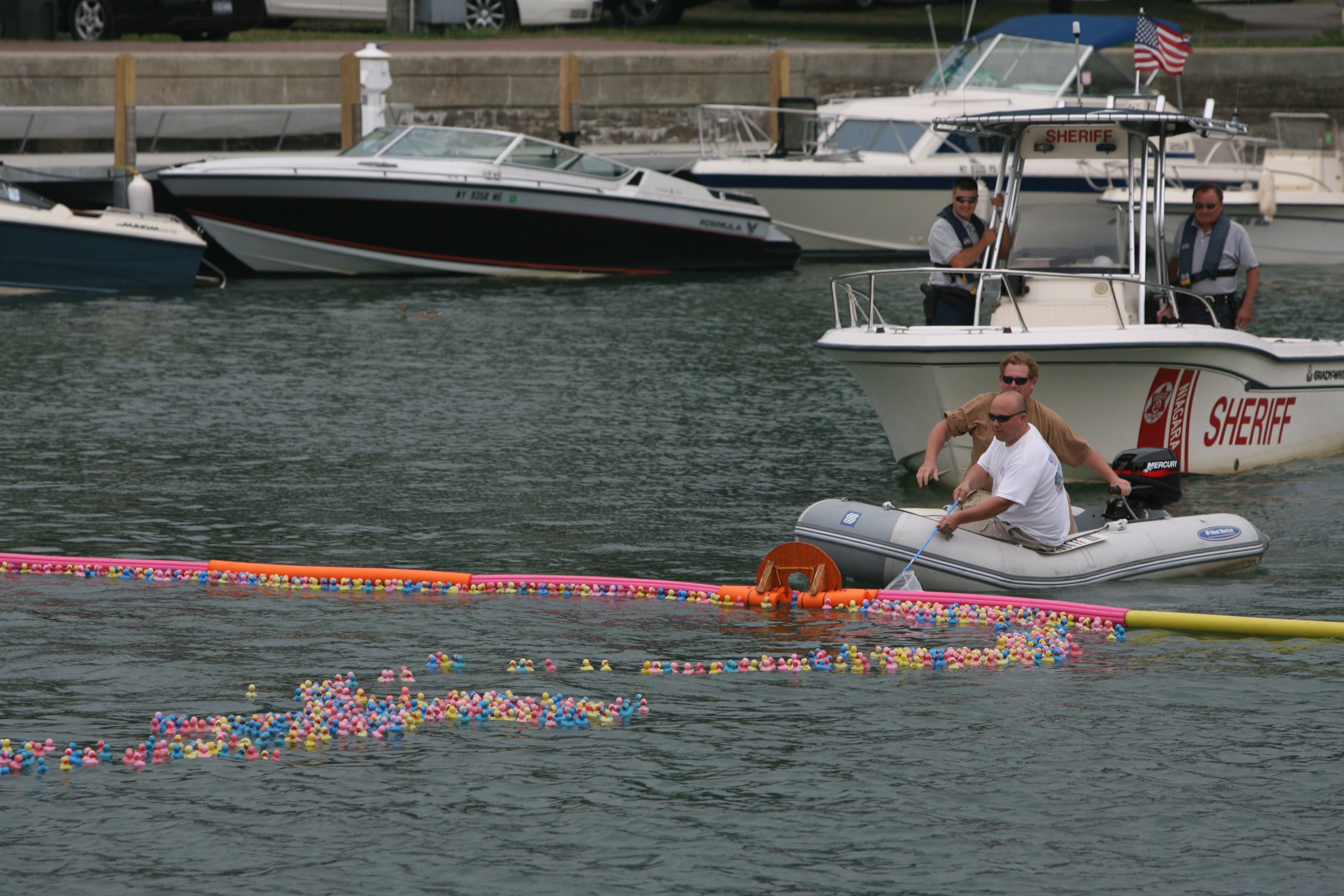 Officials get ready to scoop up multi-colored ducks at the duck race during Canalfest of the Tonawandas in 2008. (News File Photo)