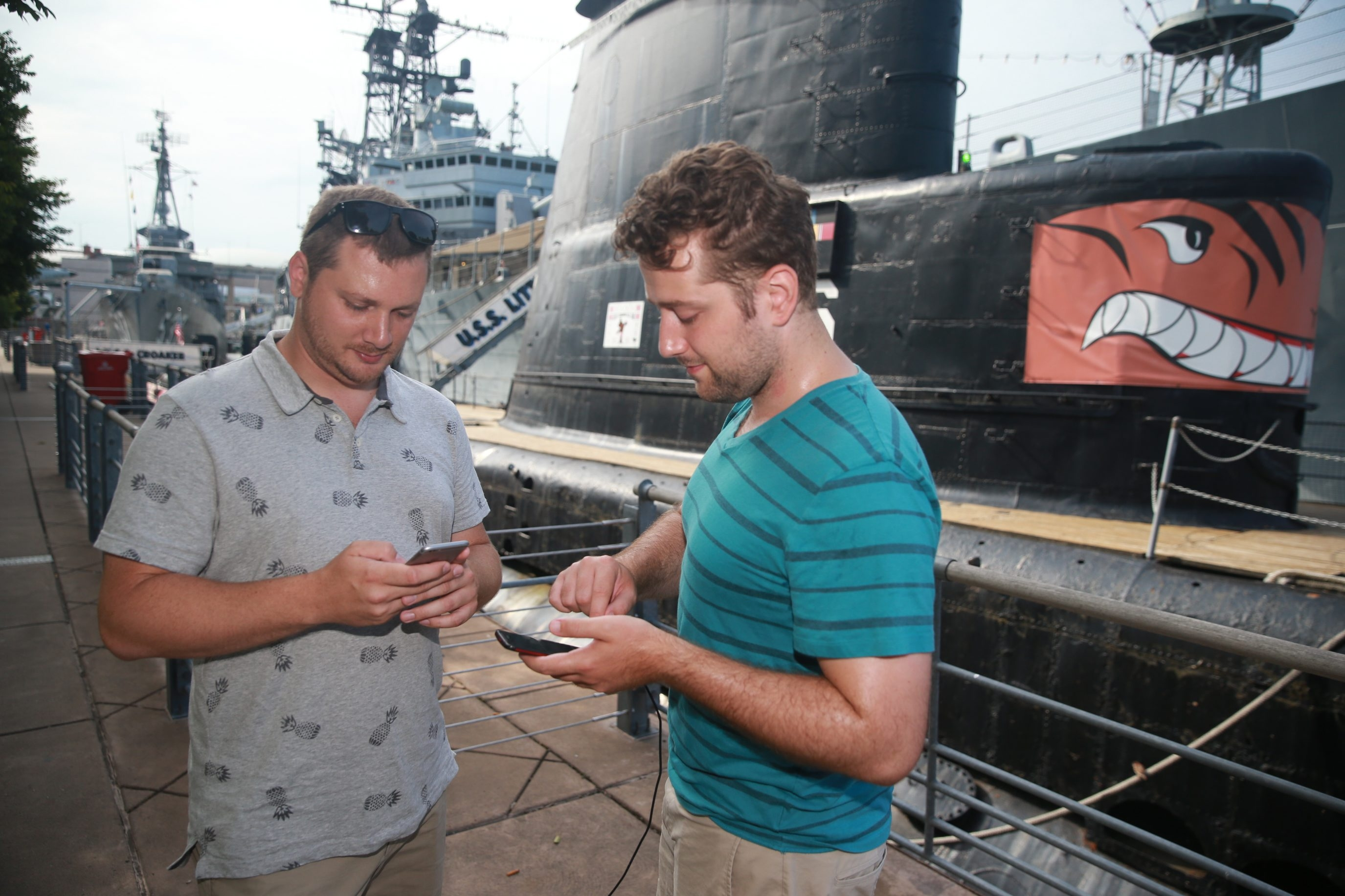 Vincent Whitney, right, of Buffalo, and Patrick Lambert, of Williamsville, POKEMON GO gamers walk and catch pokeman at  Buffalo and Erie County Naval & Military Park, in Buffalo, N.Y.,on Tuesday July 12, 2016. (John Hickey/Buffalo News)