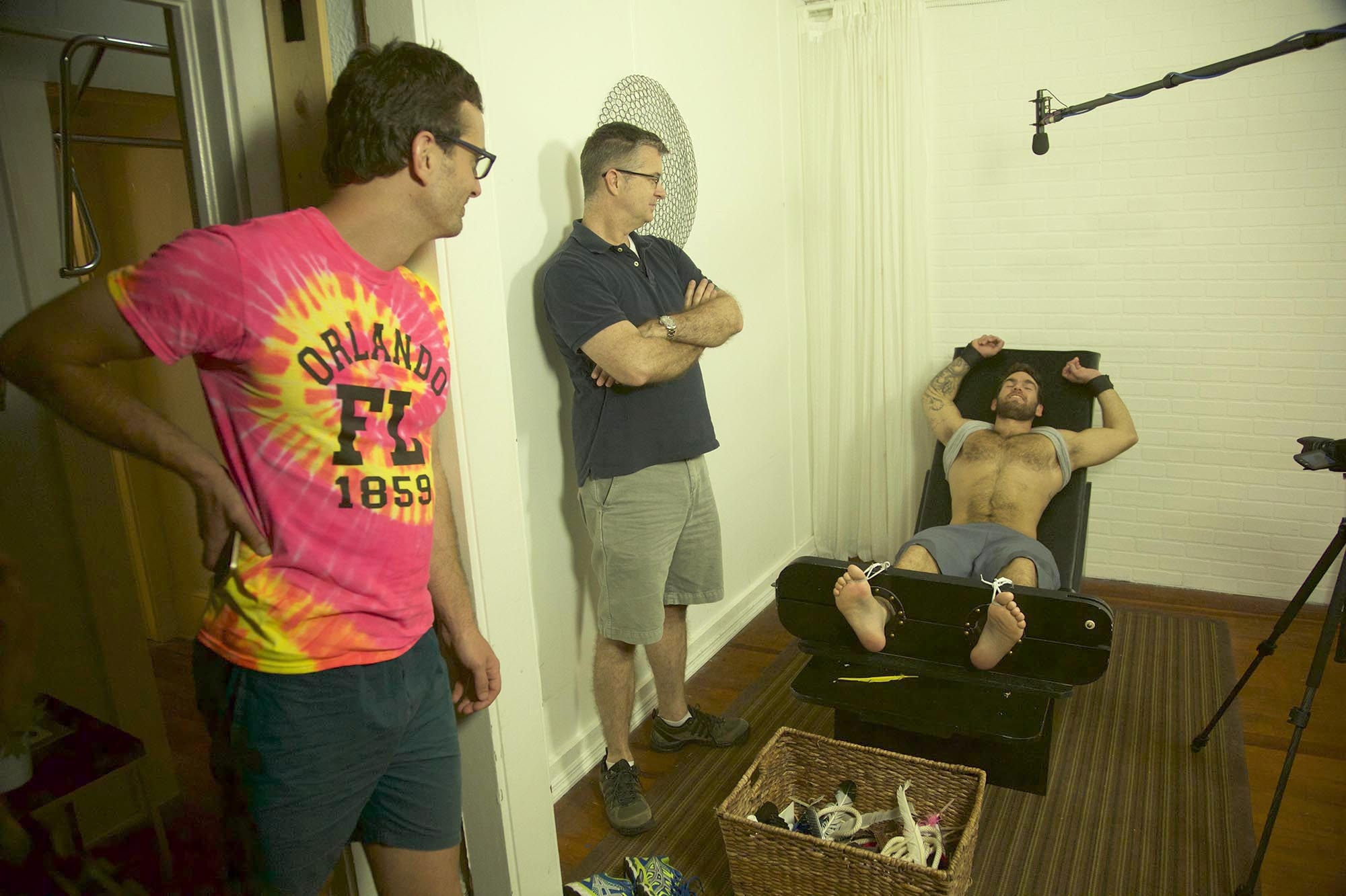 """David Farrier, Richard Ivey and a tickle subject in """"Tickled."""""""