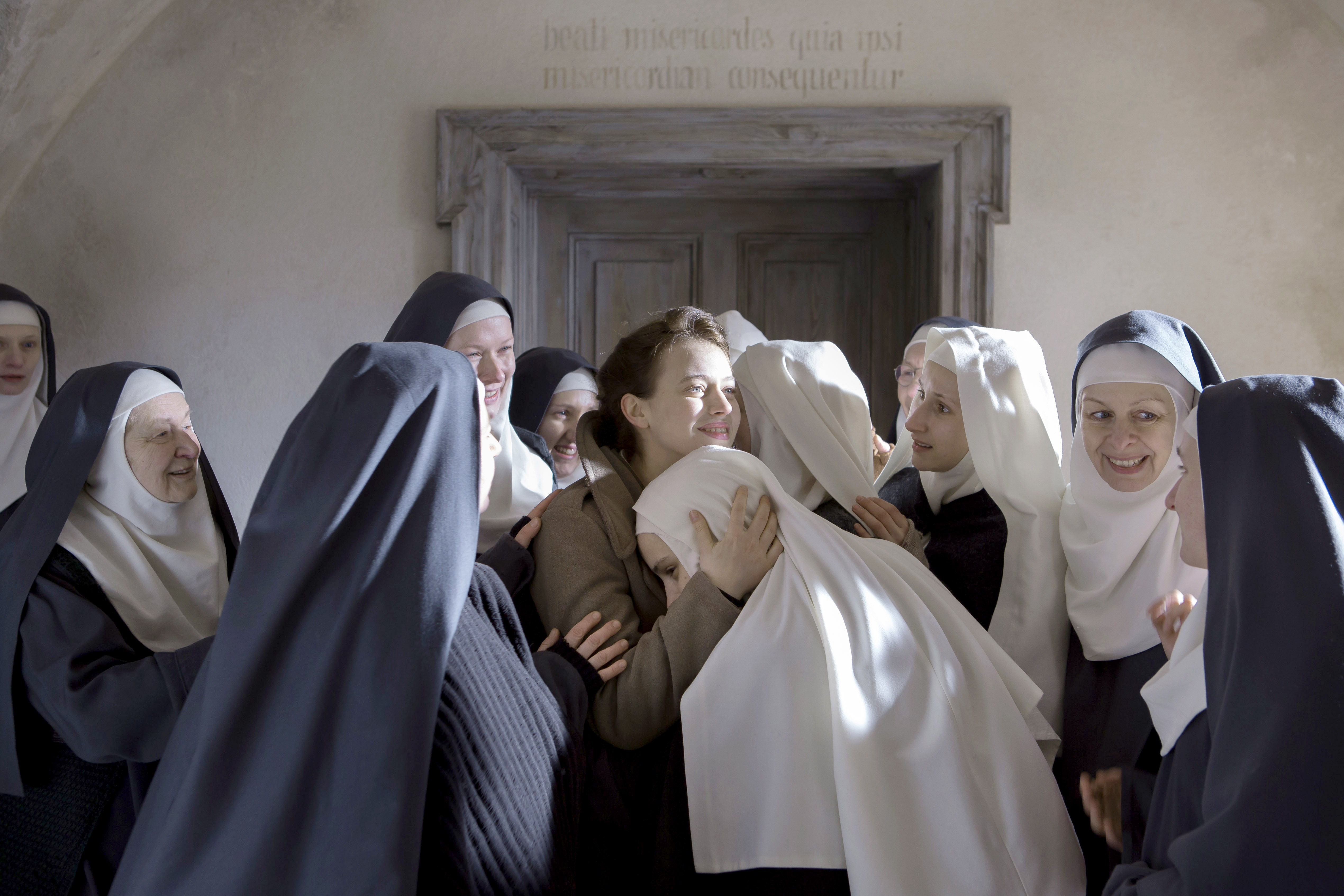 "Lou De Laage, center, in ""The Innocents,"" set in a World War II-era Polish convent."