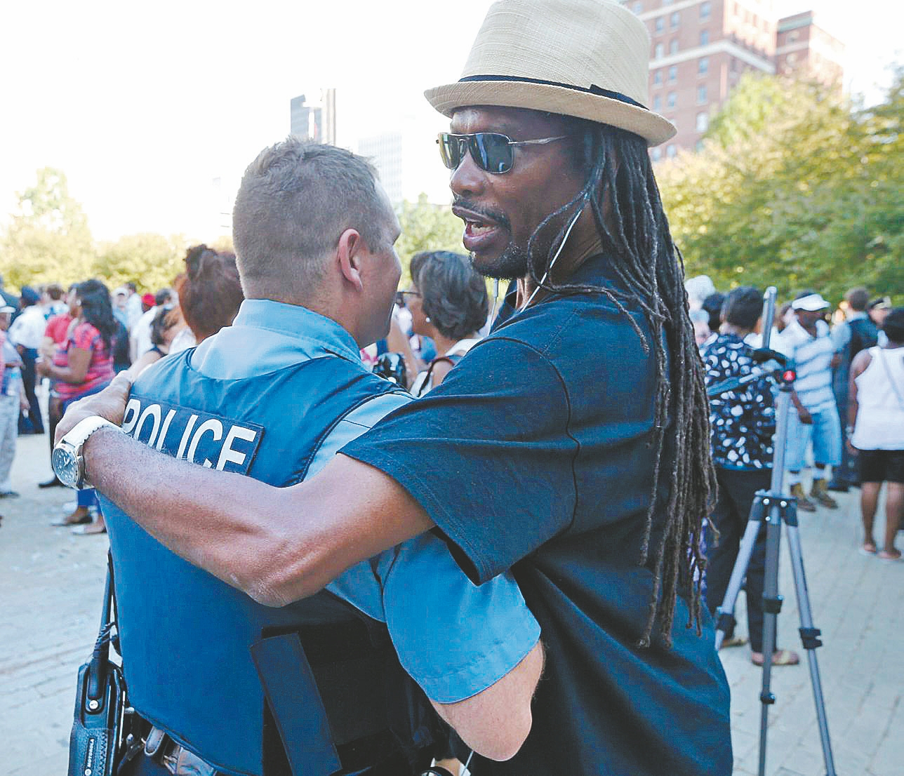 In this moving photo from Tuesday's community rally in Niagara Square, Ron Stewart, a sociology professor at SUNY Buffalo State, right, hugs a former student, Cheektowaga Police Officer Dave Vogel.