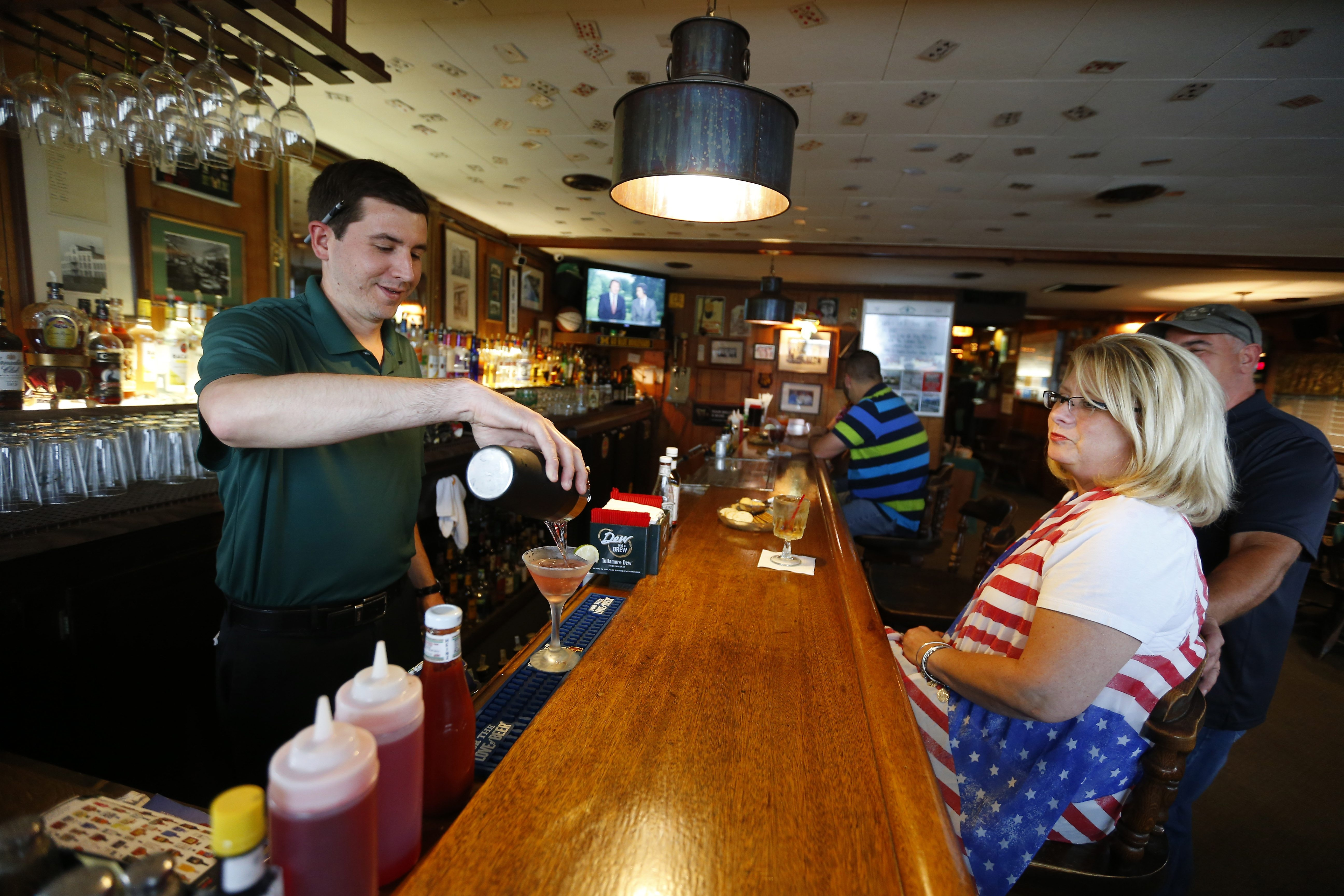 Ryan Ennis, left, pours a cosmopolitan for Renee Eberhard at Danny Sheehan's Steakhouse in Lockport, where many of the dishes failed to impress on a recent visit.