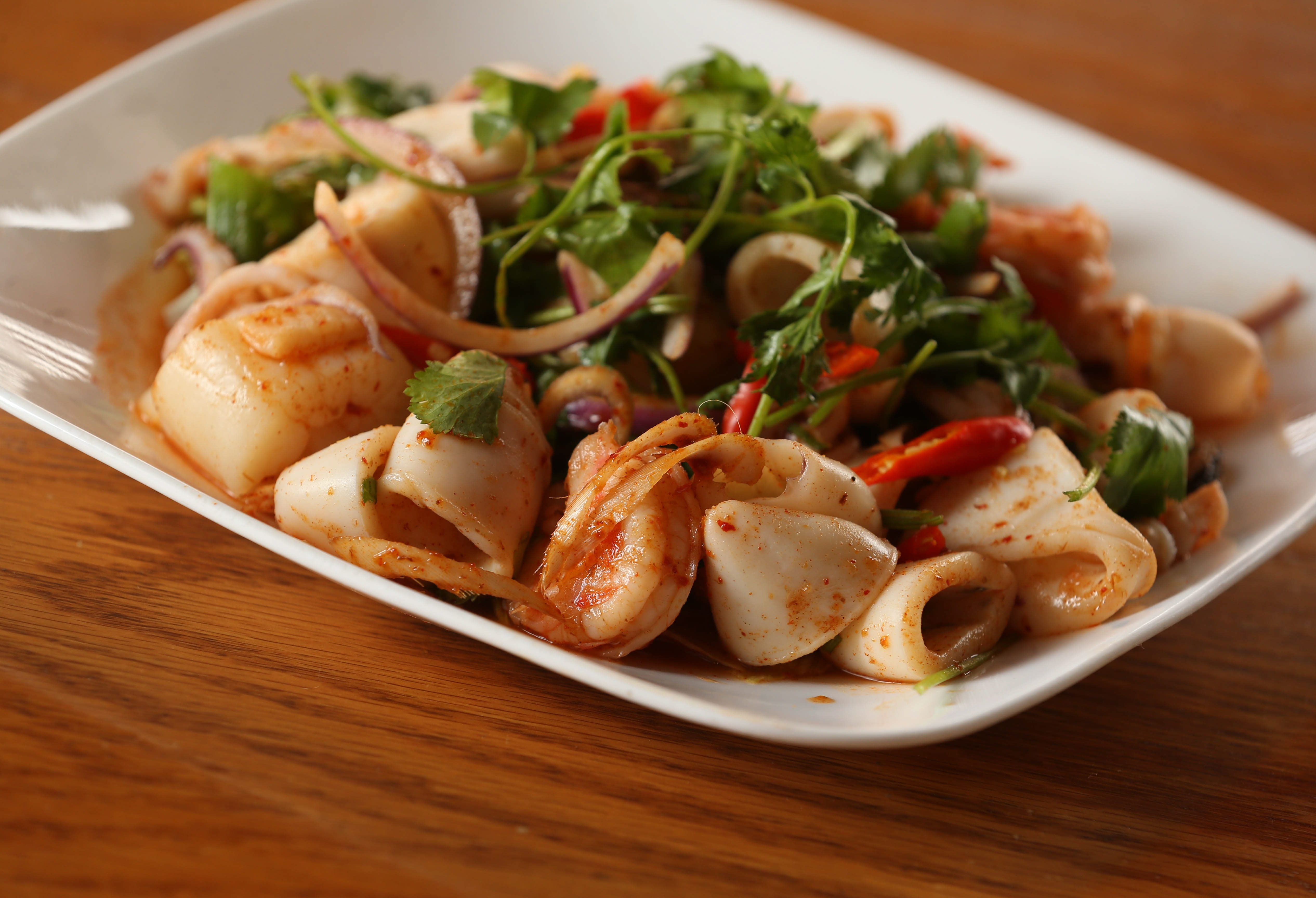Jasmine Thai at 1330 Niagara Falls Blvd. in the Town of Tonawanda, has been serving their Thai specialties for over 20 years. The yum seafood includes shrimp, scallops, calamari and mussels with onions, lemon grass, chili paste and lime juice.  Photo taken, Tuesday, July 5, 2016.  (Sharon Cantillon/Buffalo News)