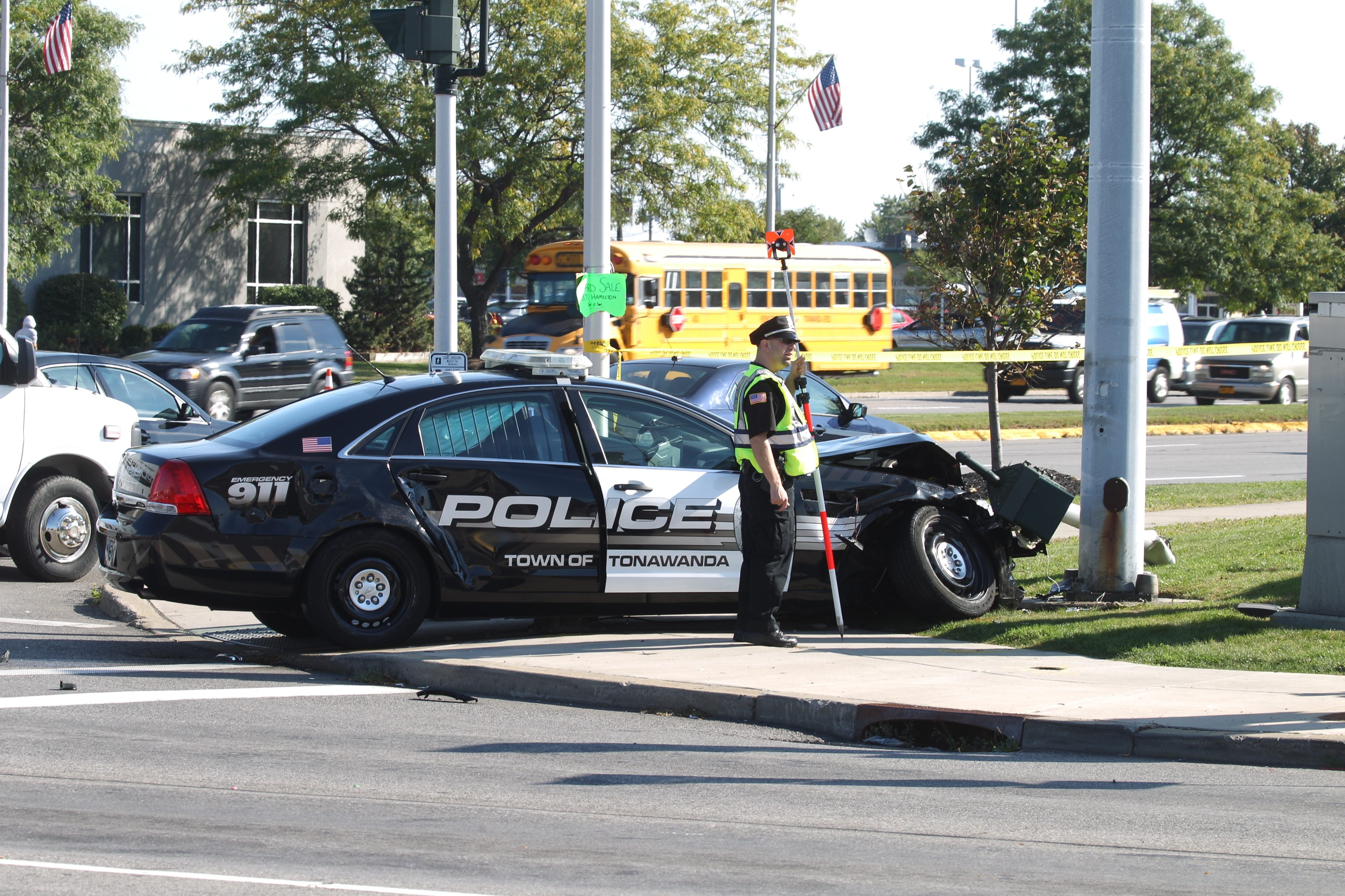 A motor vehicle accident between a Town of Tonawanda Police car responding to a call and another vehicle at  Delaware Avenue and Sheridan Drive, sent the police officer to the hospital in Town of Tonawanda, N.Y., on Thursday,  Sept. 24, 2015.     (John Hickey/Buffalo News)