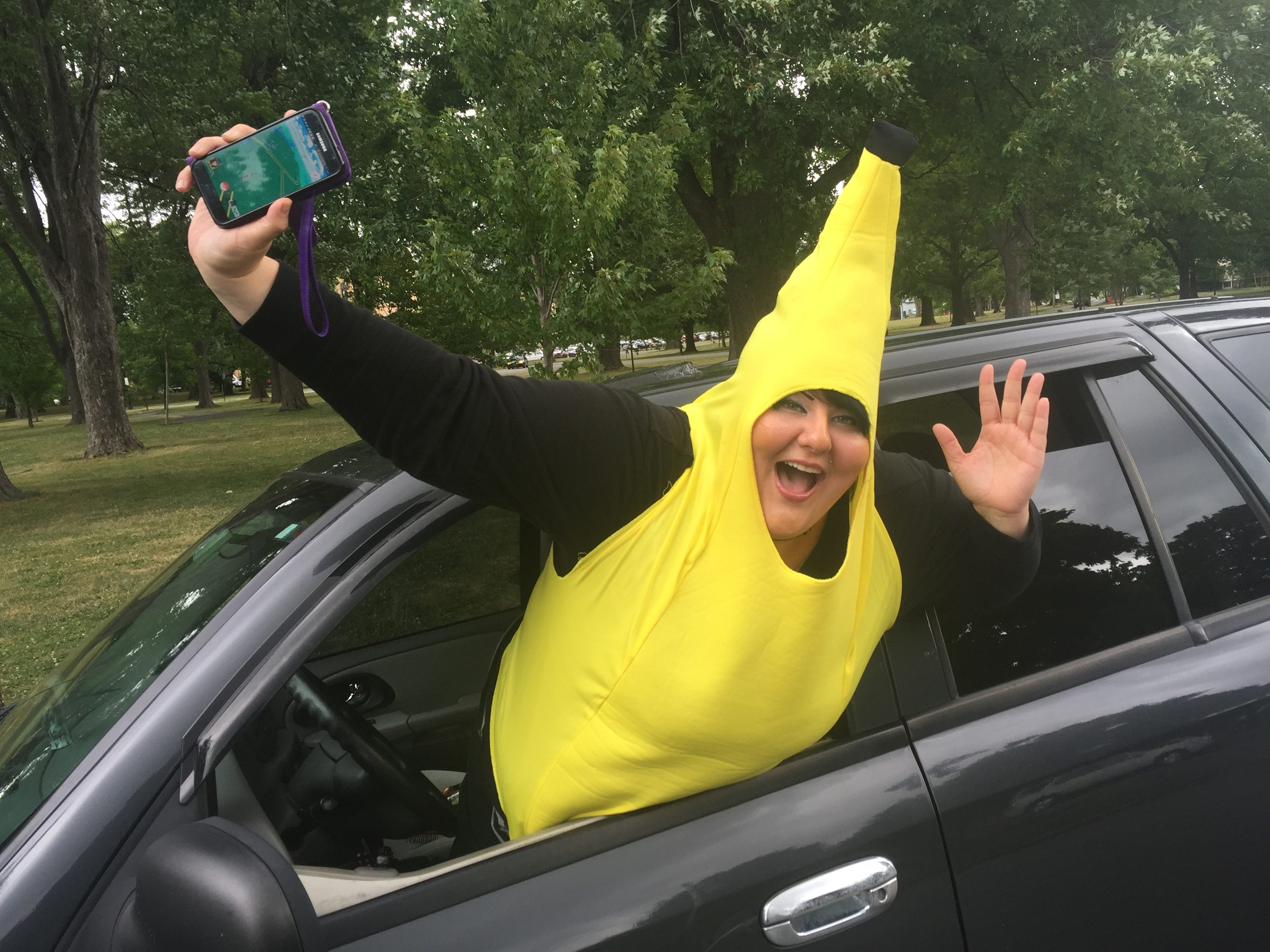 """Sarah """"Bananamama"""" Nowak advertises her chauffeur service for players of Pokémon Go, the popular augmented reality smartphone game. Nowak drives players from place to place so they can collect characters at different locales. Here she is at Cazenovia Park, Thursday."""