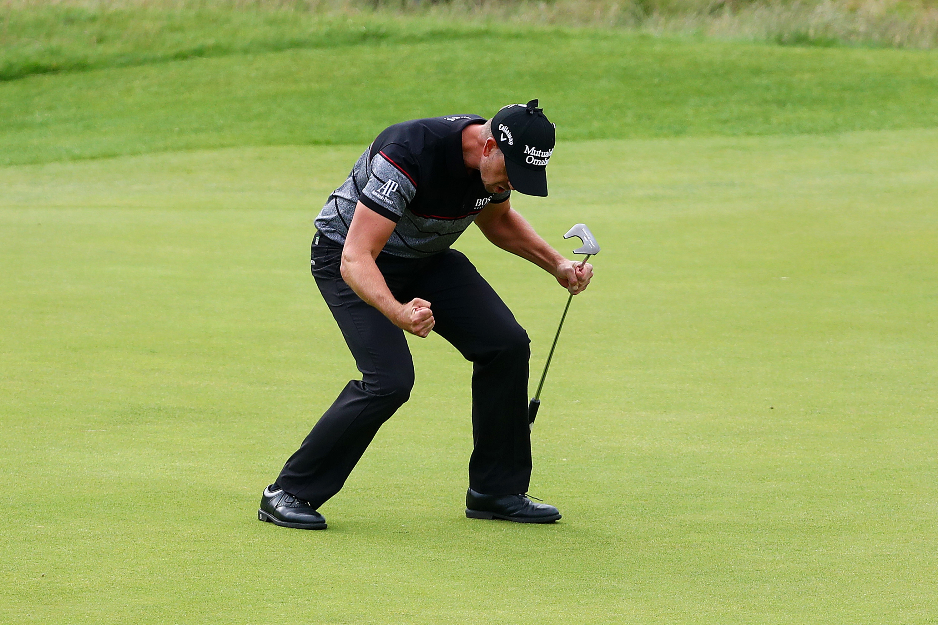 Henrik Stenson of Sweden celebrates after sinking his final putt to finish the British Open with an 8-under-par 63. He beat Phil Mickelson by three shots. (Getty Images)