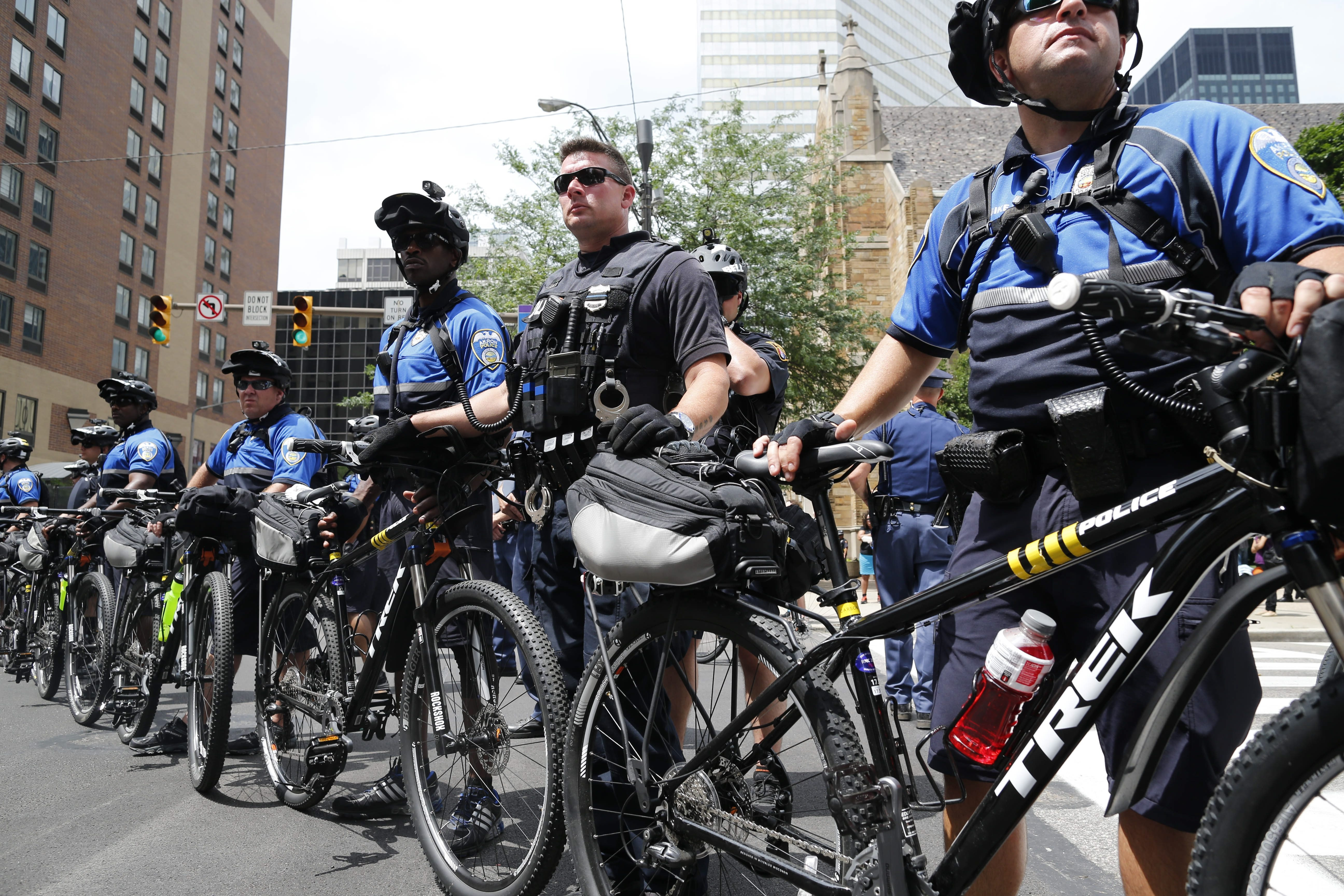 Police officers use bicycles to establish a perimeter to keep protestors from marching down an open road in Cleveland, Ohio, Monday, July 18, 2016.  (Photo by Derek Gee)