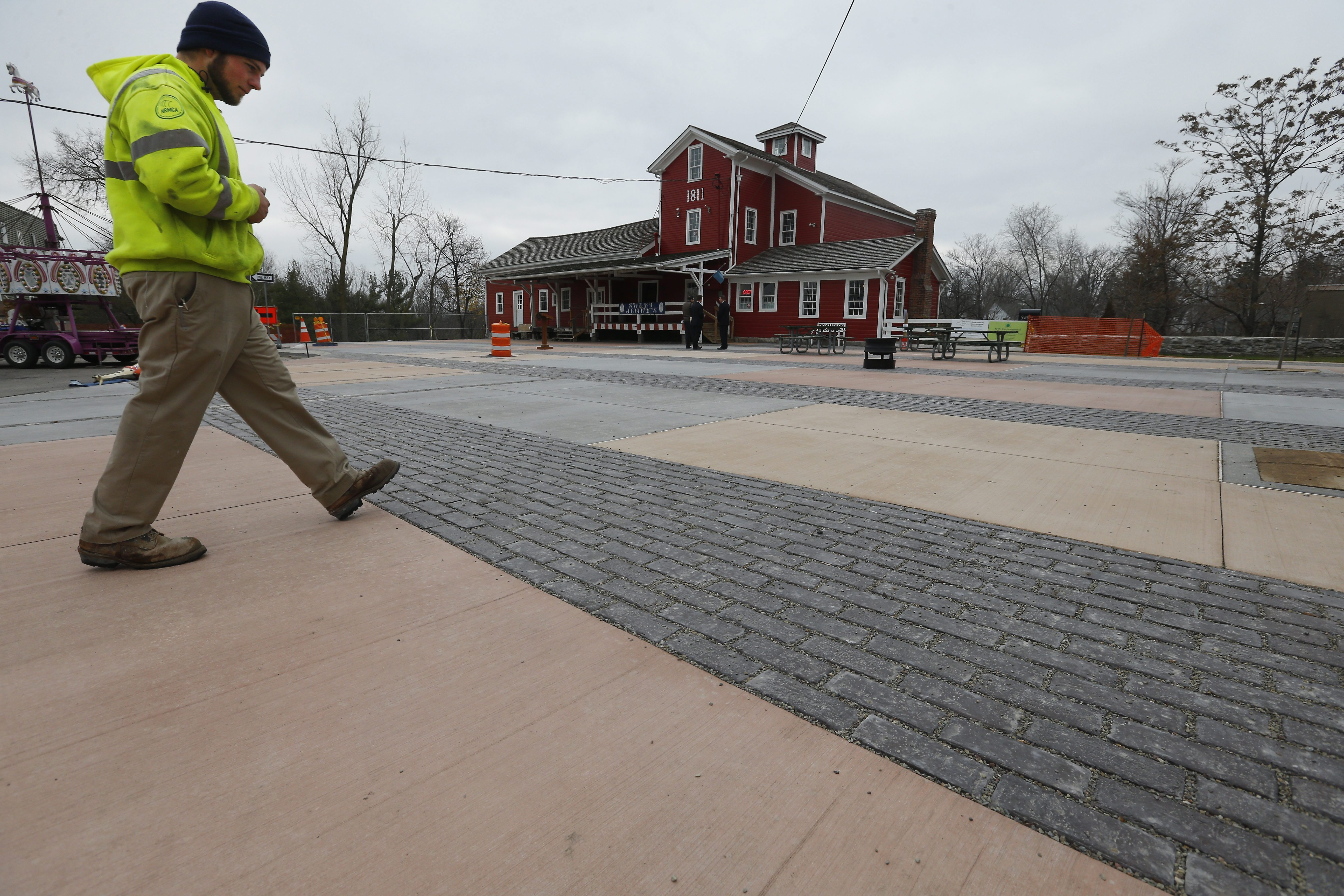 John Long of United Materials looks over the sidewalk in front of the water mill in Williamsville Dec. 4, 2015. (Mark Mulville/Buffalo News)
