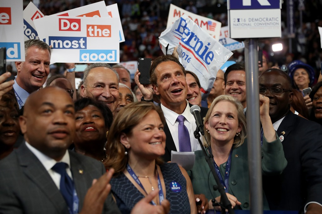 The New York delegation casts their votes during roll call along with (Center L-R) New York City Mayor Bill De Blasio, Sen. Chuck Schumer (D-NY), Rep. Charles Rangel (D-NY), New York Gov. Andrew Cuomo, and Sen. Kirsten Gillibrand (D-NY), on the second day of the Democratic National Convention at the Wells Fargo Center, July 26, 2016 in Philadelphia. (Getty Images)
