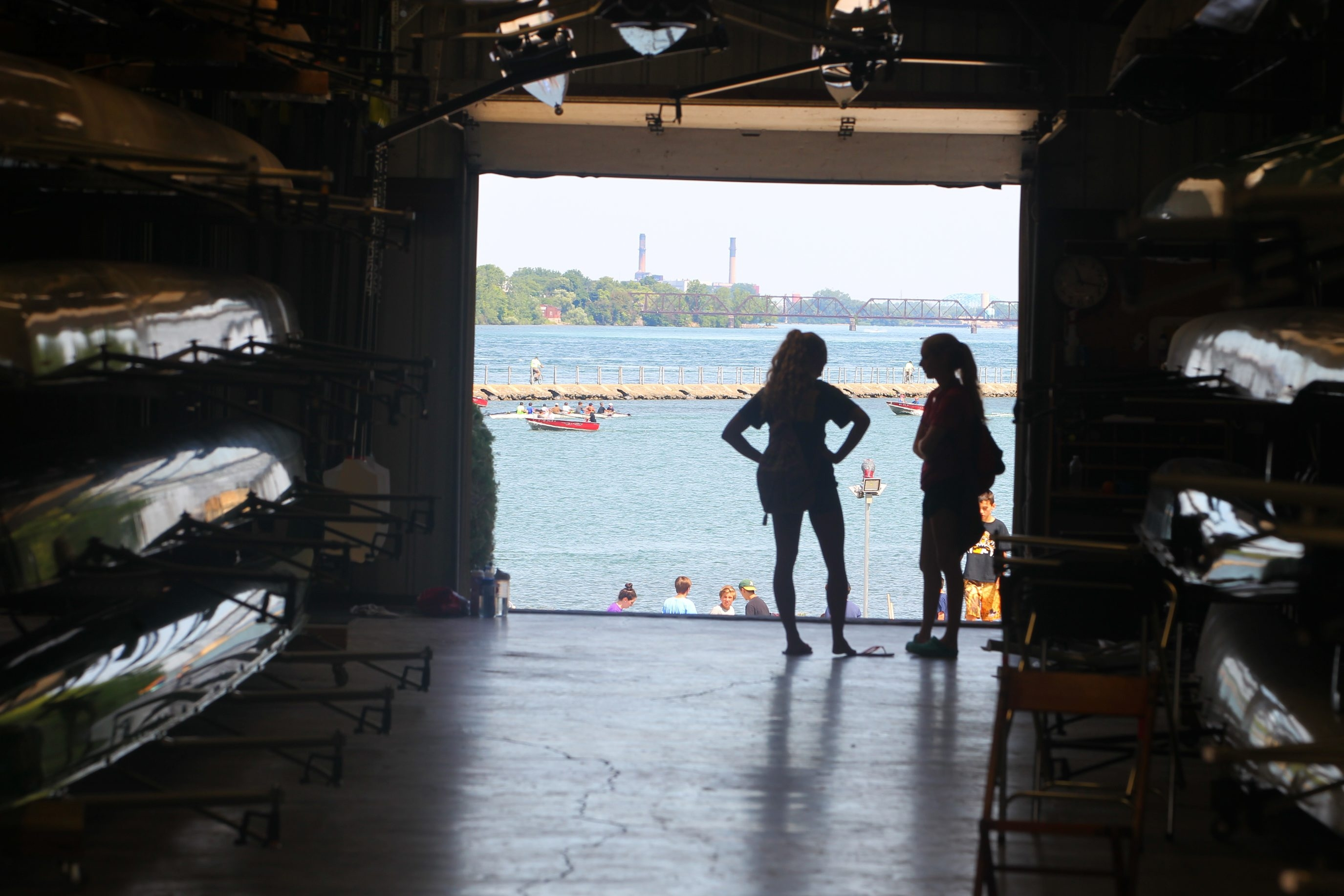The sun silhouettes rowers in the Doc Schaab Boat House at the West Side Rowing Club in Buffalo on July 20, 2016.