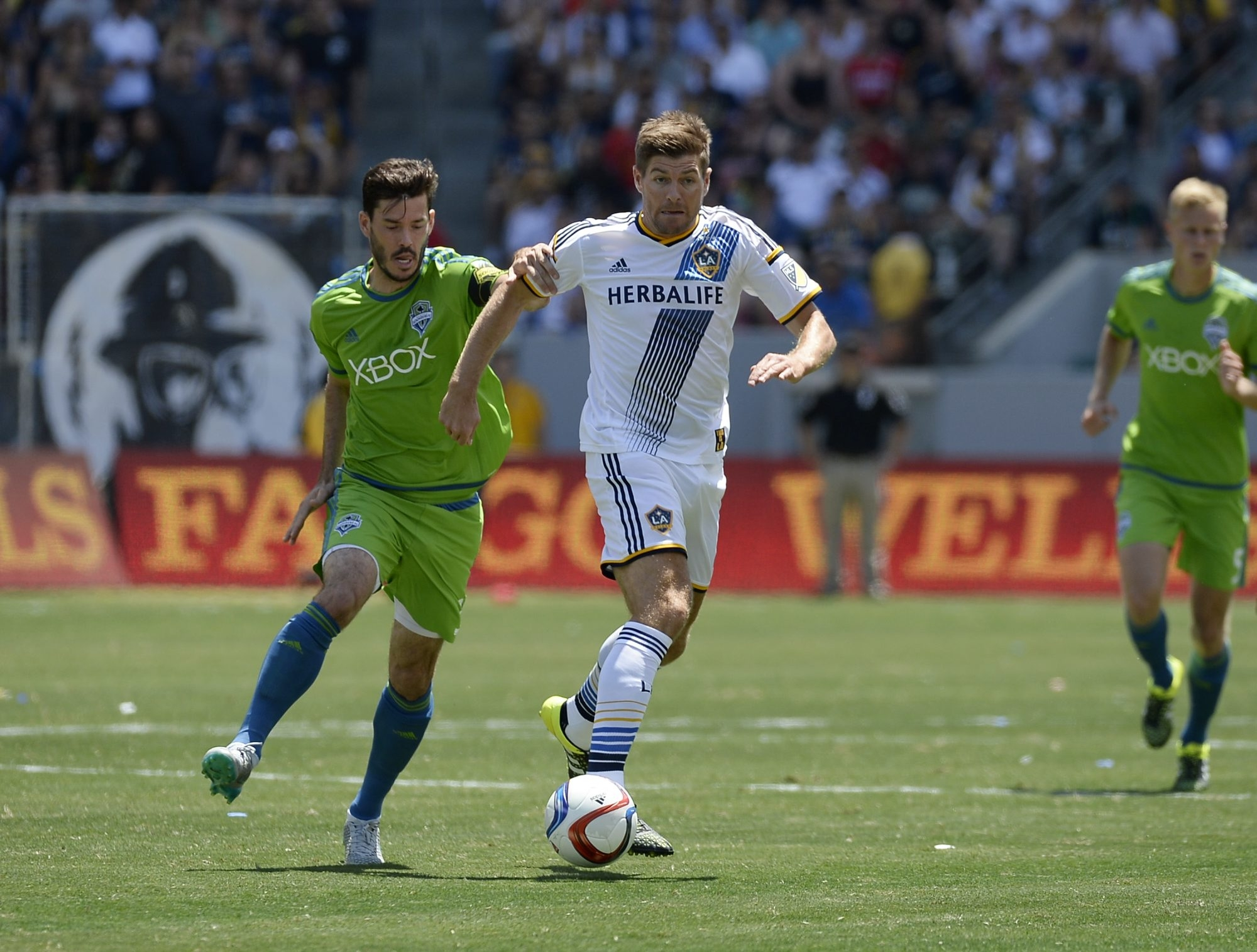 Steven Gerrard (8) of the Los Angeles Galaxy drives the ball against Brad Evans (3) of the Seattle Sounders on Aug. 9, 2015.