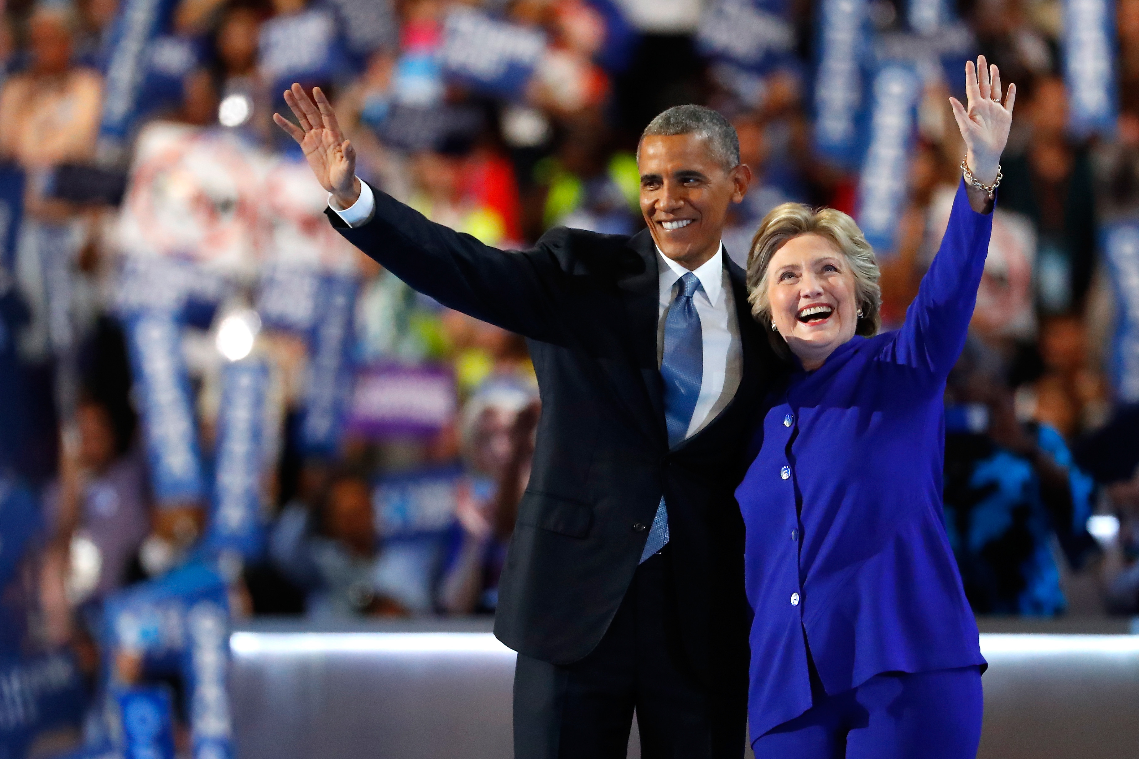 PHILADELPHIA, PA - JULY 27:  US President Barack Obama and Democratic presidential candidate Hillary Clinton wave to the crowd on the third day of the Democratic National Convention at the Wells Fargo Center, July 27, 2016 in Philadelphia, Pennsylvania. Democratic presidential candidate Hillary Clinton received the number of votes needed to secure the party's nomination. An estimated 50,000 people are expected in Philadelphia, including hundreds of protesters and members of the media. The four-day Democratic National Convention kicked off July 25.  (Photo by Aaron P. Bernstein/Getty Images)