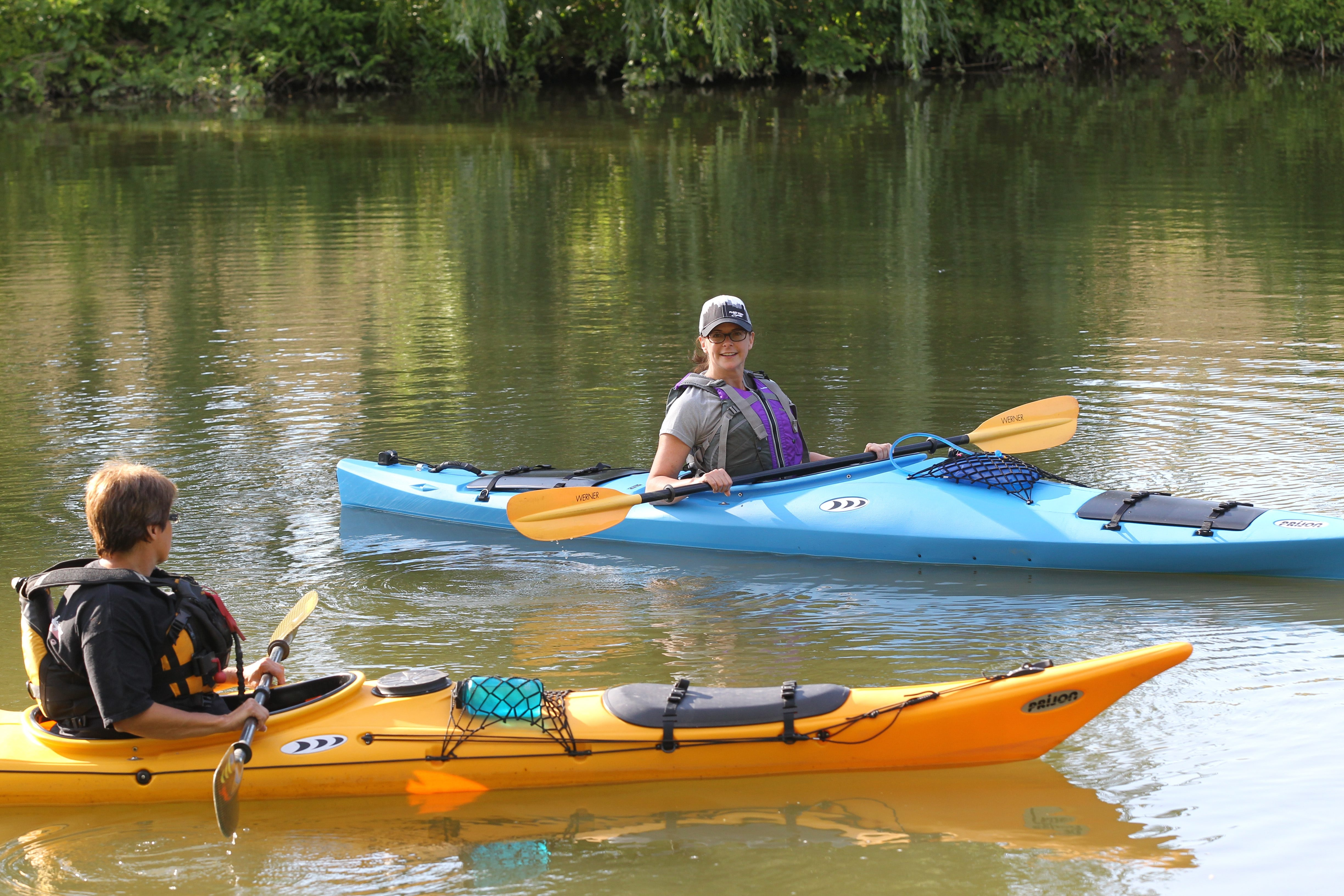 """Sandy York enjoys kayaking on Ellicott Creek in the Town of Tonawanda. """"As soon as I get in the water and push off the shore, I feel the stress melt away,"""" she says of kayaking on the peaceful waterway. (James P. McCoy/Buffalo News)"""