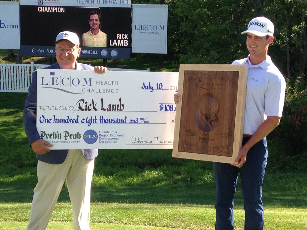 Rick Lamb poses with the winner's trophy and check along with Peek'n Peak owner Nick Scott following the final round of the LECOM Health Challenge. (Jay Skurski/Buffalo News)