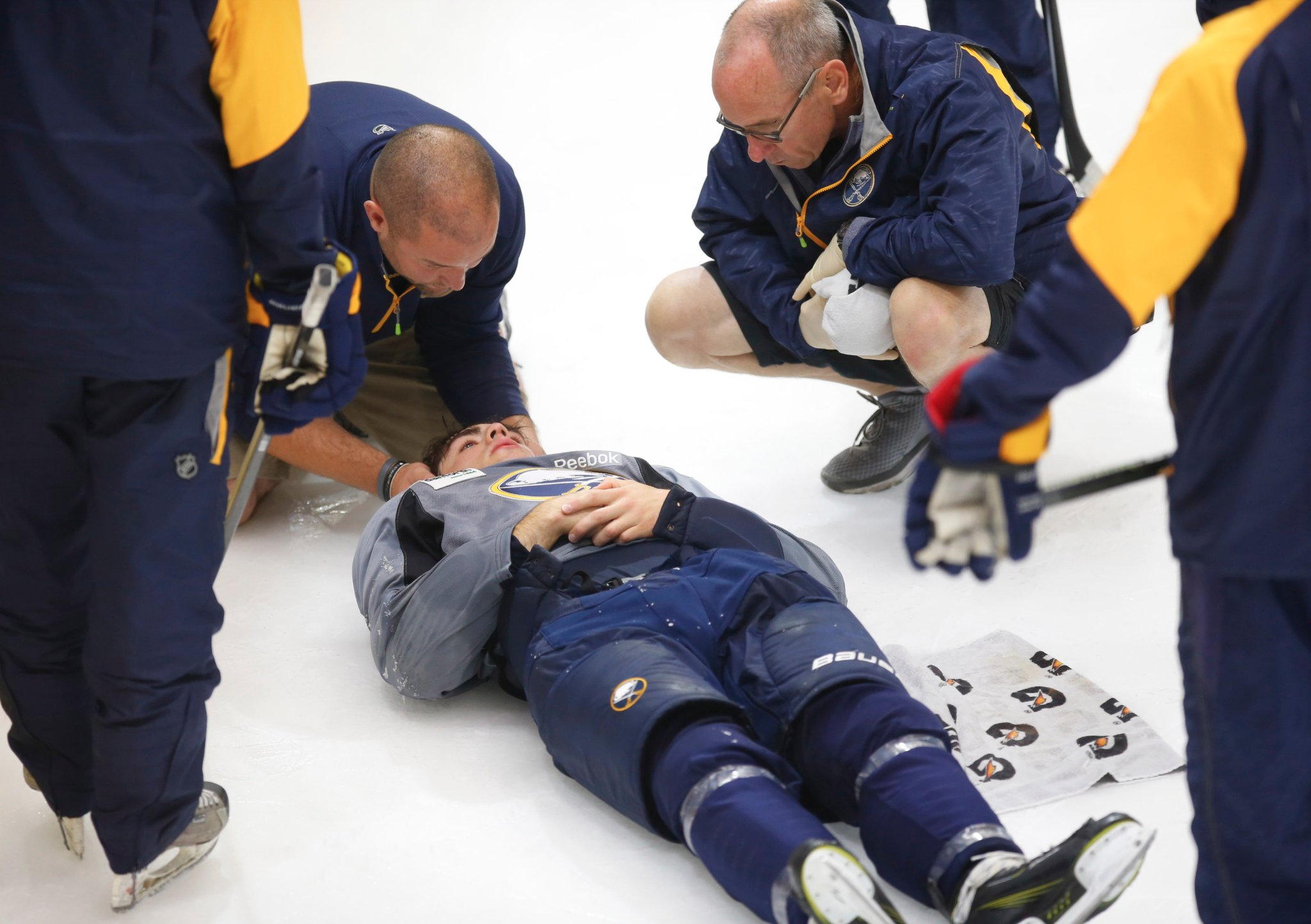 Michael Campoli lays on the ice after being injured during the Sabres development camp 3-on-3 tournament. (Harry Scull Jr./Buffalo News)