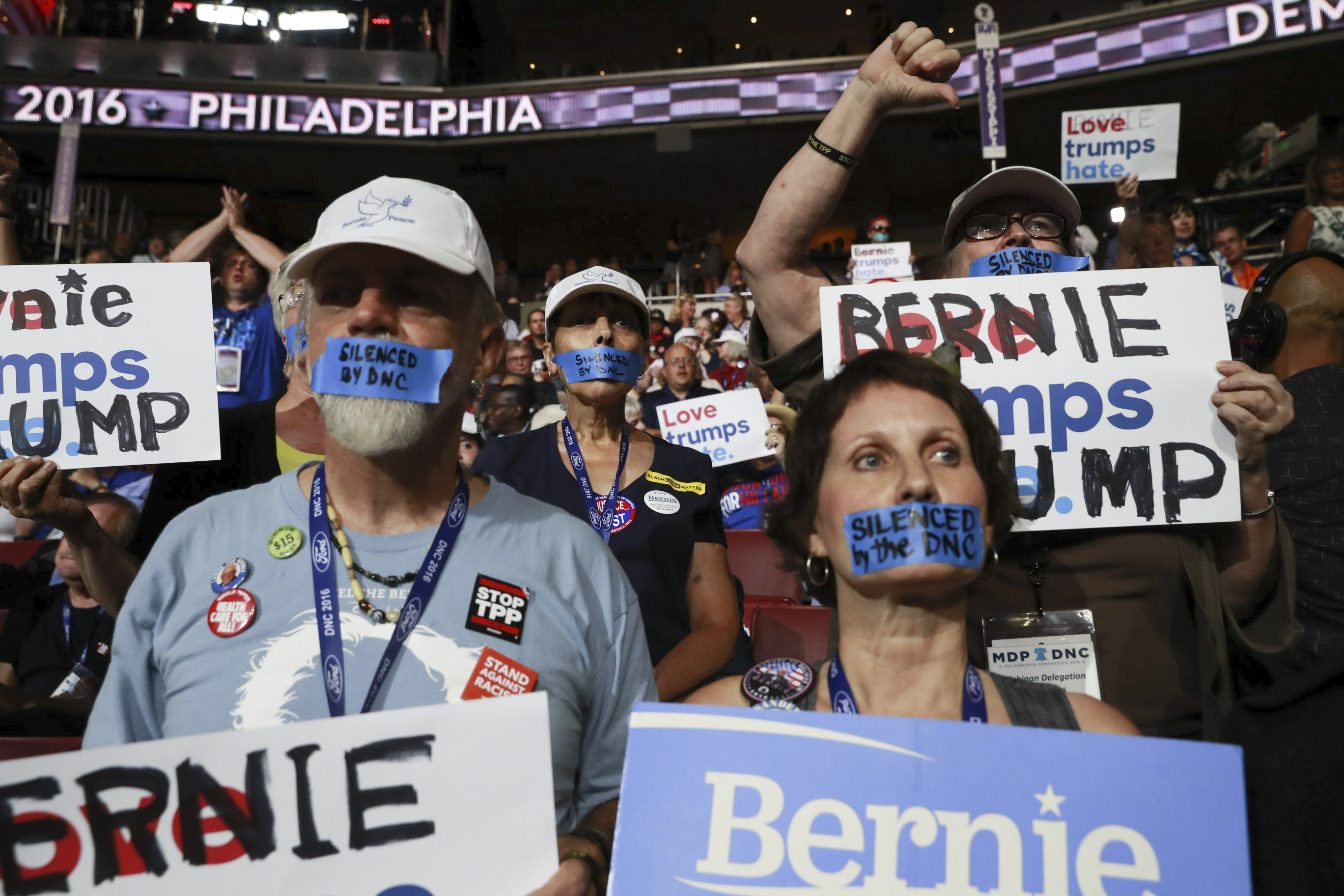 Supporters of Bernie Sanders silently protest at the Wells Fargo Center on the first day of the Democratic National Convention in Philadelphia. Later, they'd lead a boisterous 'No TPP' chant during the speakers' portion of the night. (Josh Haner/The New York Times)