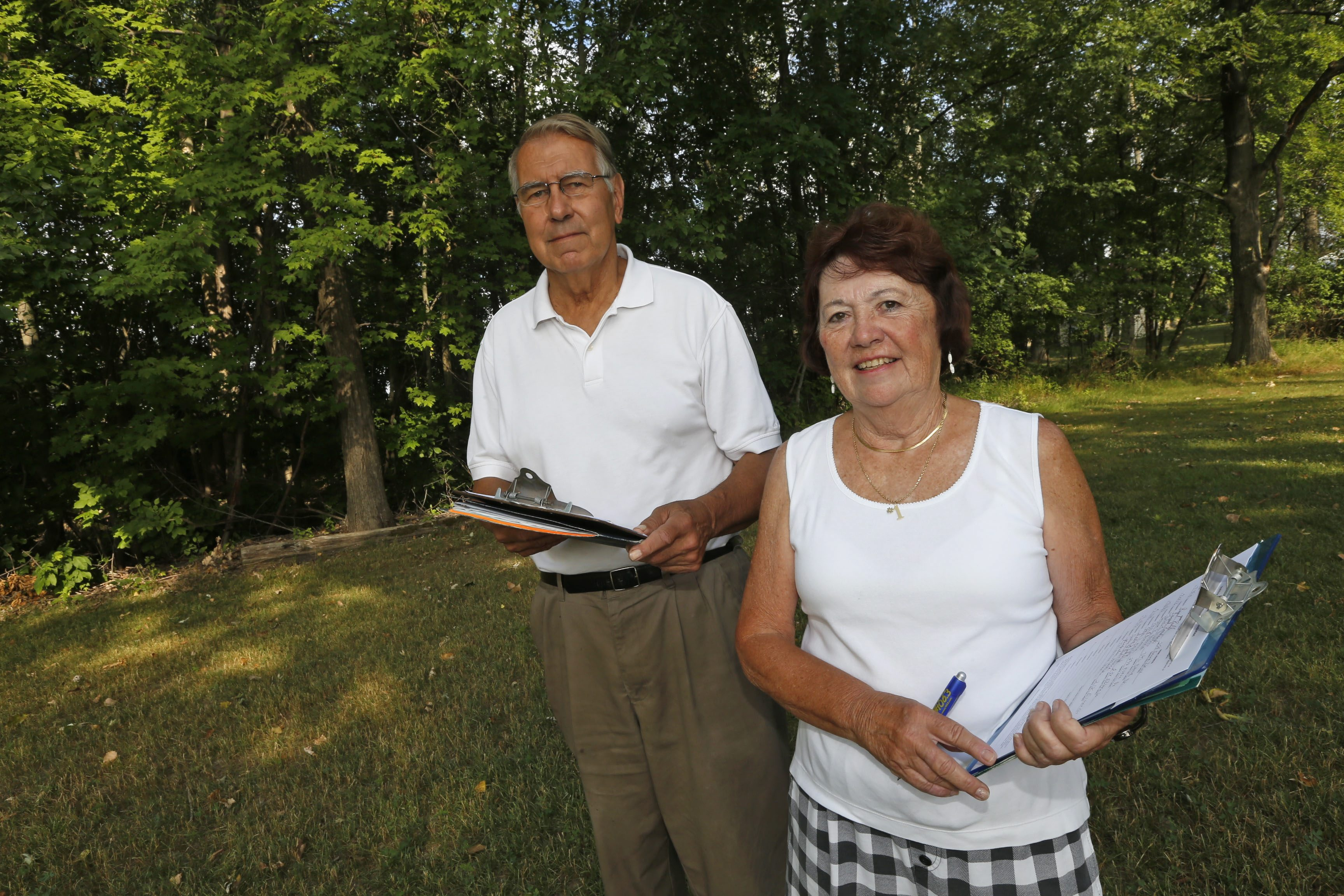 Joan Priebe and Irvine. G. Reinig II have been soliciting signatures to cause a referendum to dissolve the Village of Depew. (Robert Kirkham/Buffalo News)