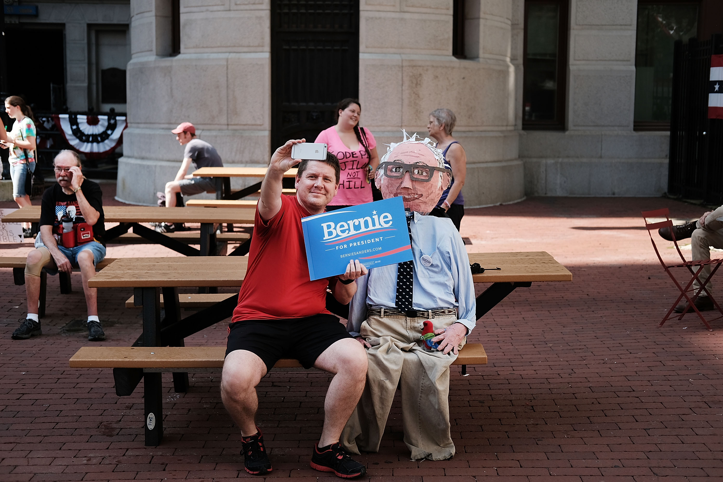A Bernie Sanders supporter takes a selfie with a Sanders puppet before a march through downtown Philadelphia on the first day of the Democratic National Convention.  (Spencer Platt/Getty Images)