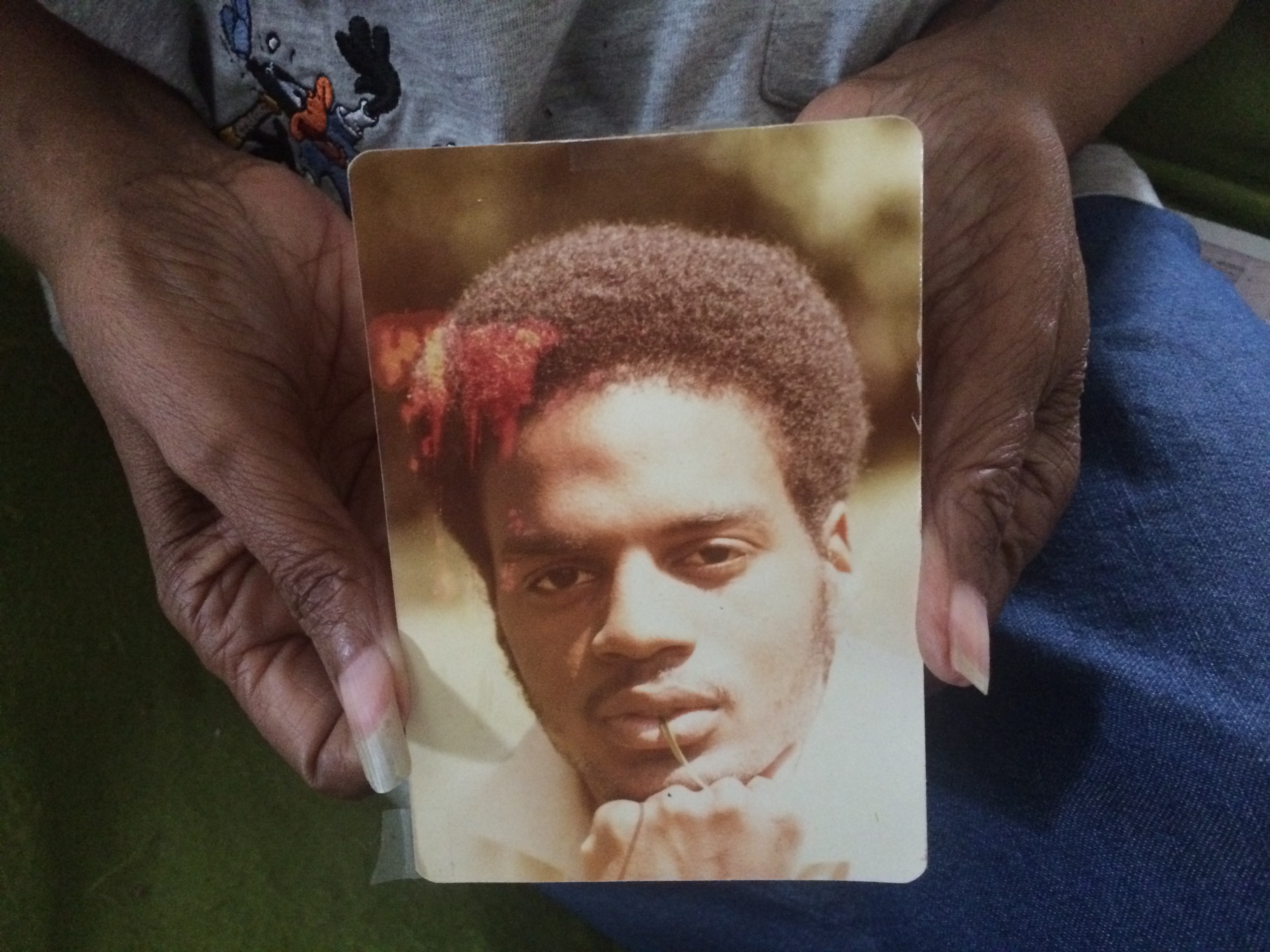 Delores Howard holds a photograph of her son, Wallie Howard Jr., a Syracuse police investigator killed in the line of duty, Oct. 30, 1990 (Sean Kirst/Submitted image)