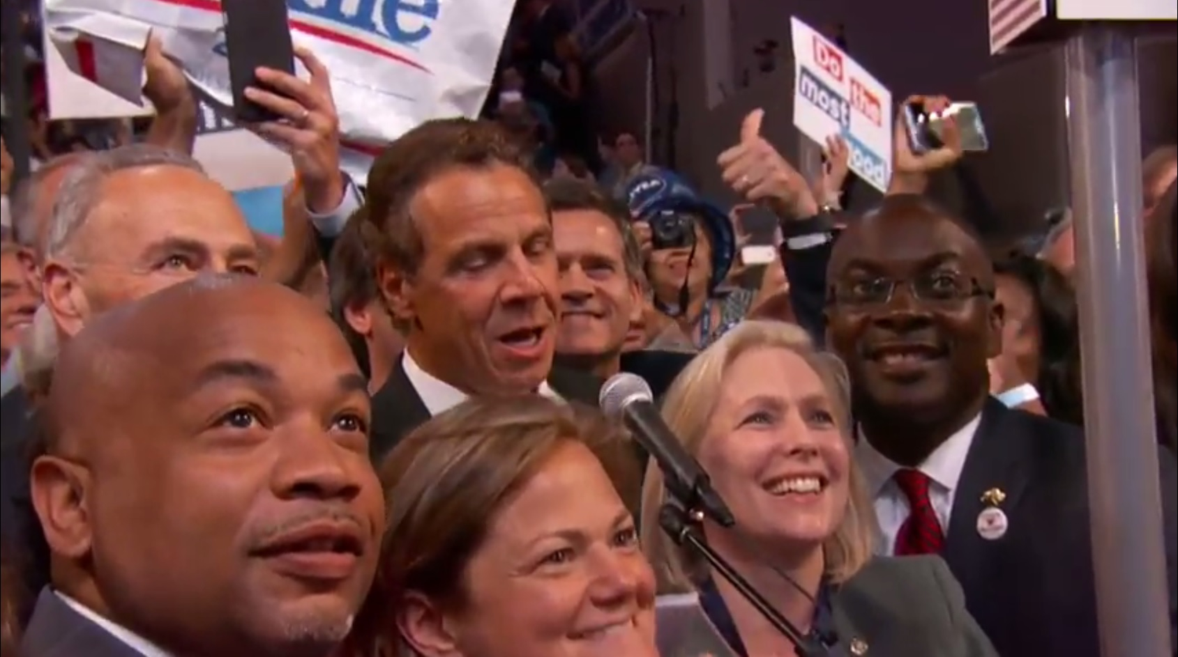 Mayor Byron Brown and Sen. Kirsten Gillibrand look on as Governor Andrew Cuomo casts the votes for the New York delegation at the Democratic convention on Tuesday.