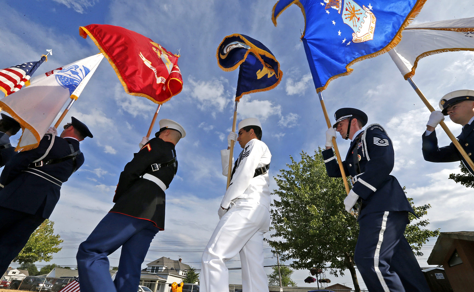 The honor guard representing the branches of the military bring in the colors.  The Town of Tonawanda honored the resident veterans of the Town and the Village of Kenmore at a special ceremony at Kenney Field.  The Town Board paid tribute to the Resident Combat Veterans of the Afghanistan, Iraq and Gulf Wars on Sunday, July 3, 2016.  (Robert Kirkham/Buffalo News)