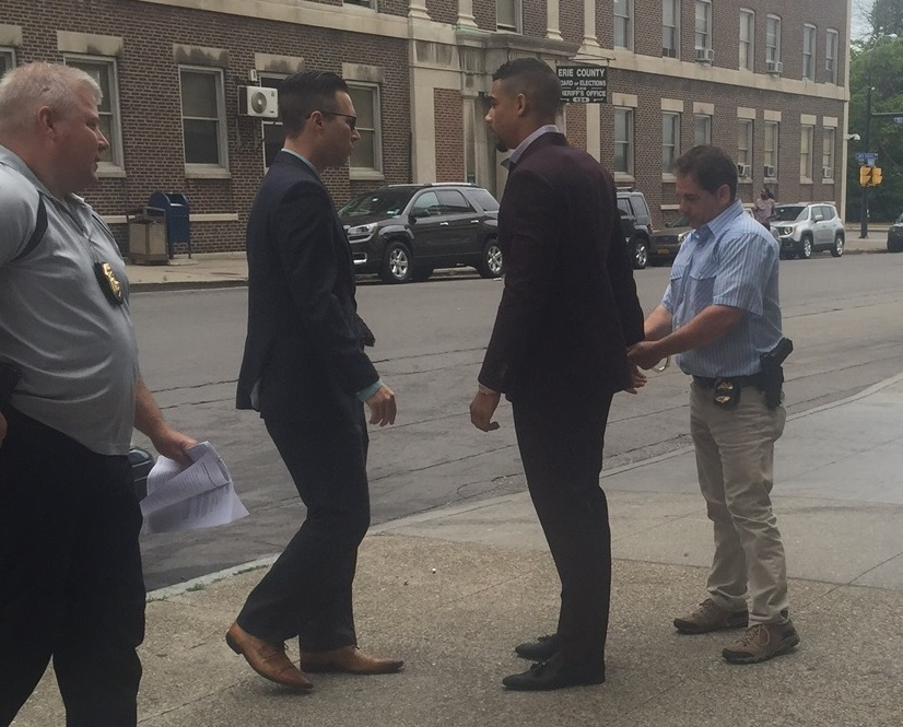 Buffalo Sabres forward Evander Kane is handcuffed by Buffalo police as he was charged Friday in connection with a June incident at a Buffalo bar. (Jane Kwiatkowski / Buffalo News)