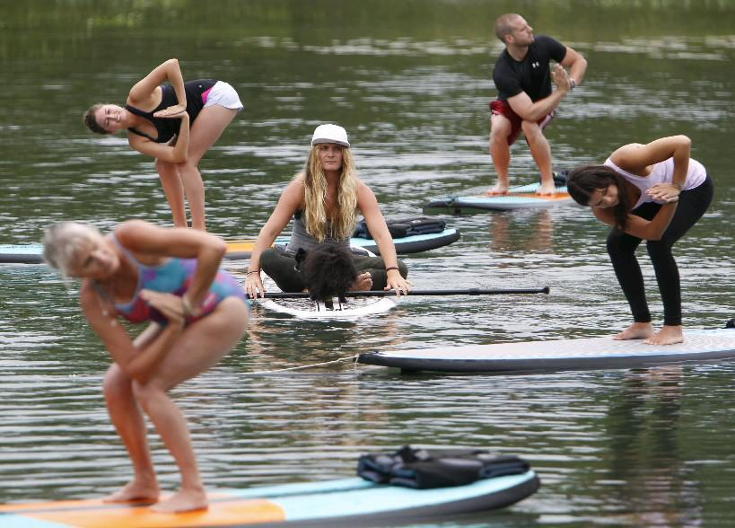 Marie Phillips leads stand-up paddleboard yoga classes at Beaver Island State Park on Grand Island and in Buffalo. (Sharon Cantillon/Buffalo News file photo)