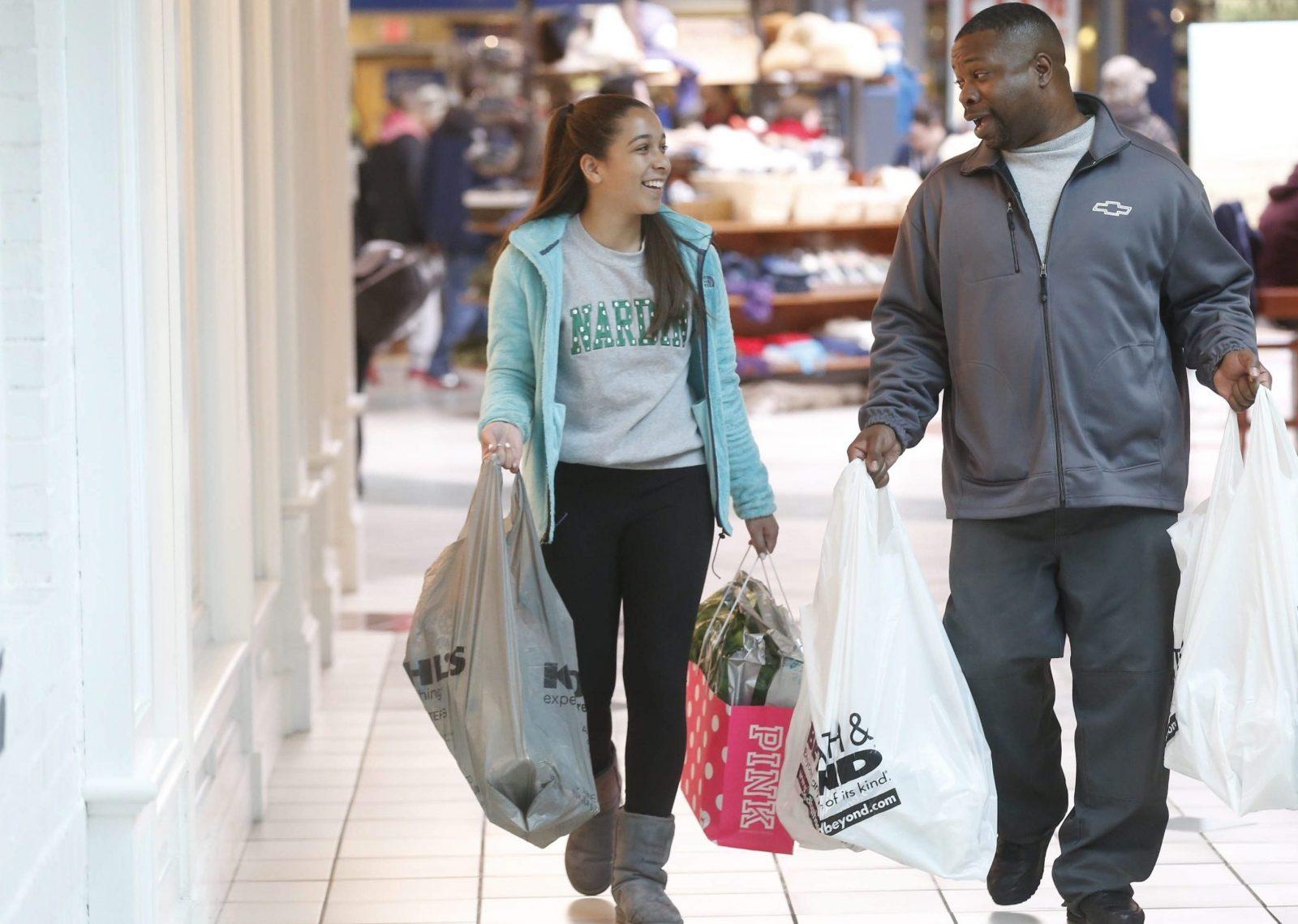 David Hartley and his daughter Alyssa, 13, of Amherst, shop at Boulevard Mall on Niagara Falls Boulevard. (Robert Kirkham/Buffalo News)
