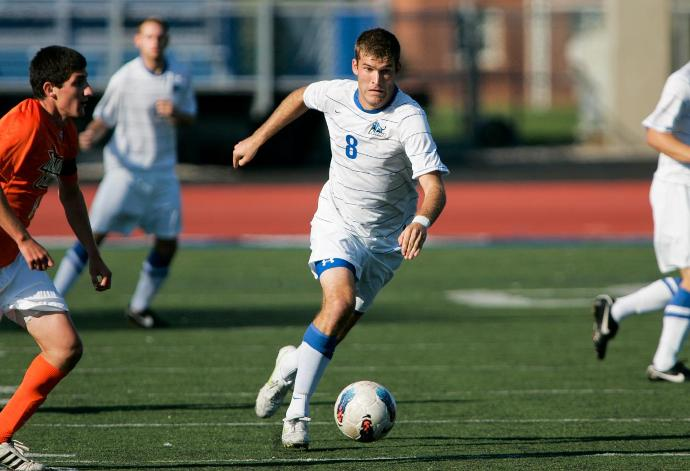 Andy Tiedt, No. 8 in white, leads SoHo FC against BSC Raiders in the BN Soccer Match of the Week. (UB Athletics)
