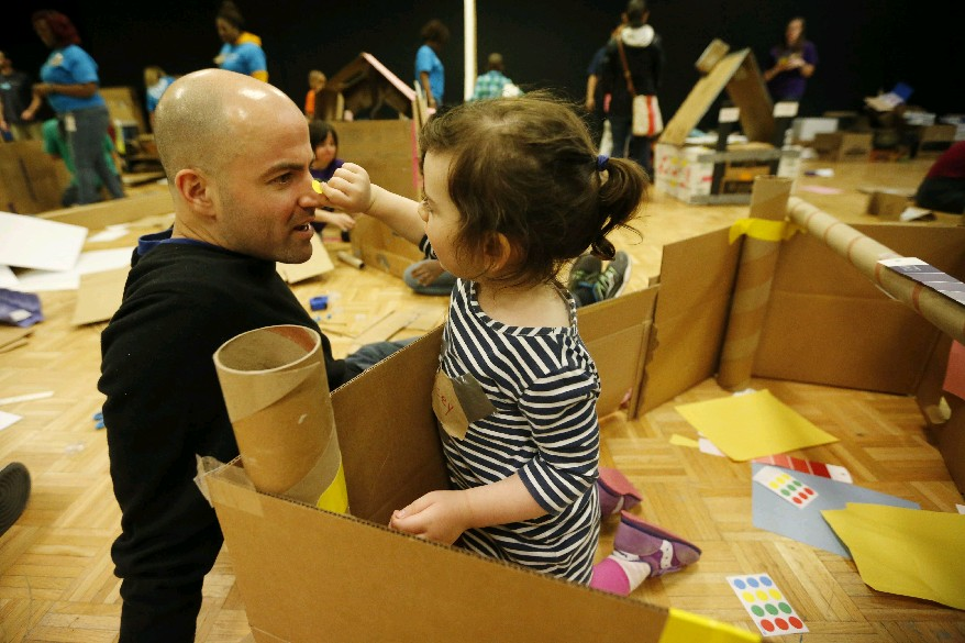 Zoey Joslyn, 2, and her dad, Rich, clown around while building a castle out of cardboard at the Buffalo Museum of Science. (Derek Gee/Buffalo News)