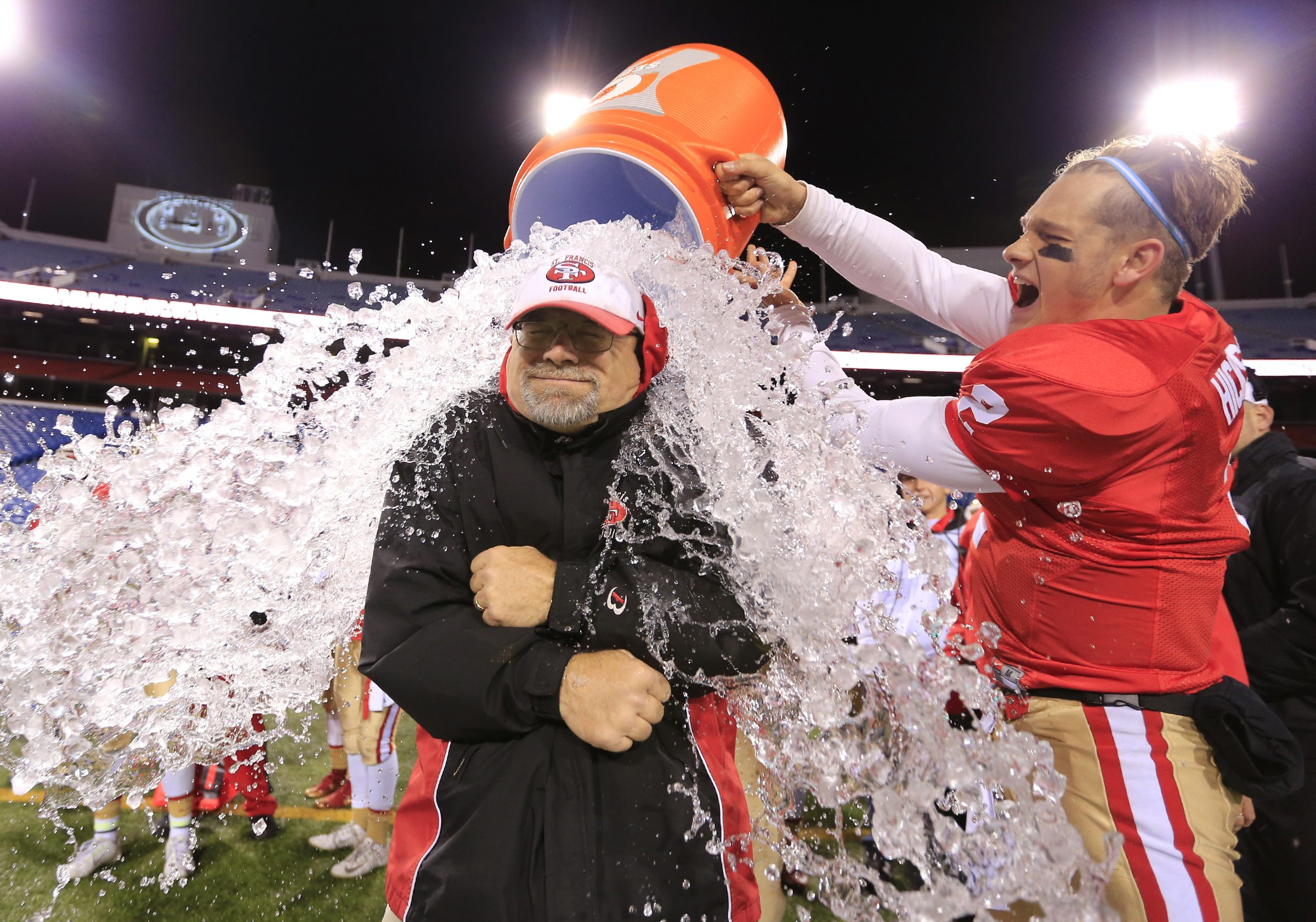 St. Francis coach Jerry Smith gets the celebratory Gatorade bucket shower following the Red Raiders' triumph over Canisius in the Monsignor Martin Association championship game last November at New Era Field, the former Ralph Wilson Stadium. (Harry Scull Jr./Buffalo News)