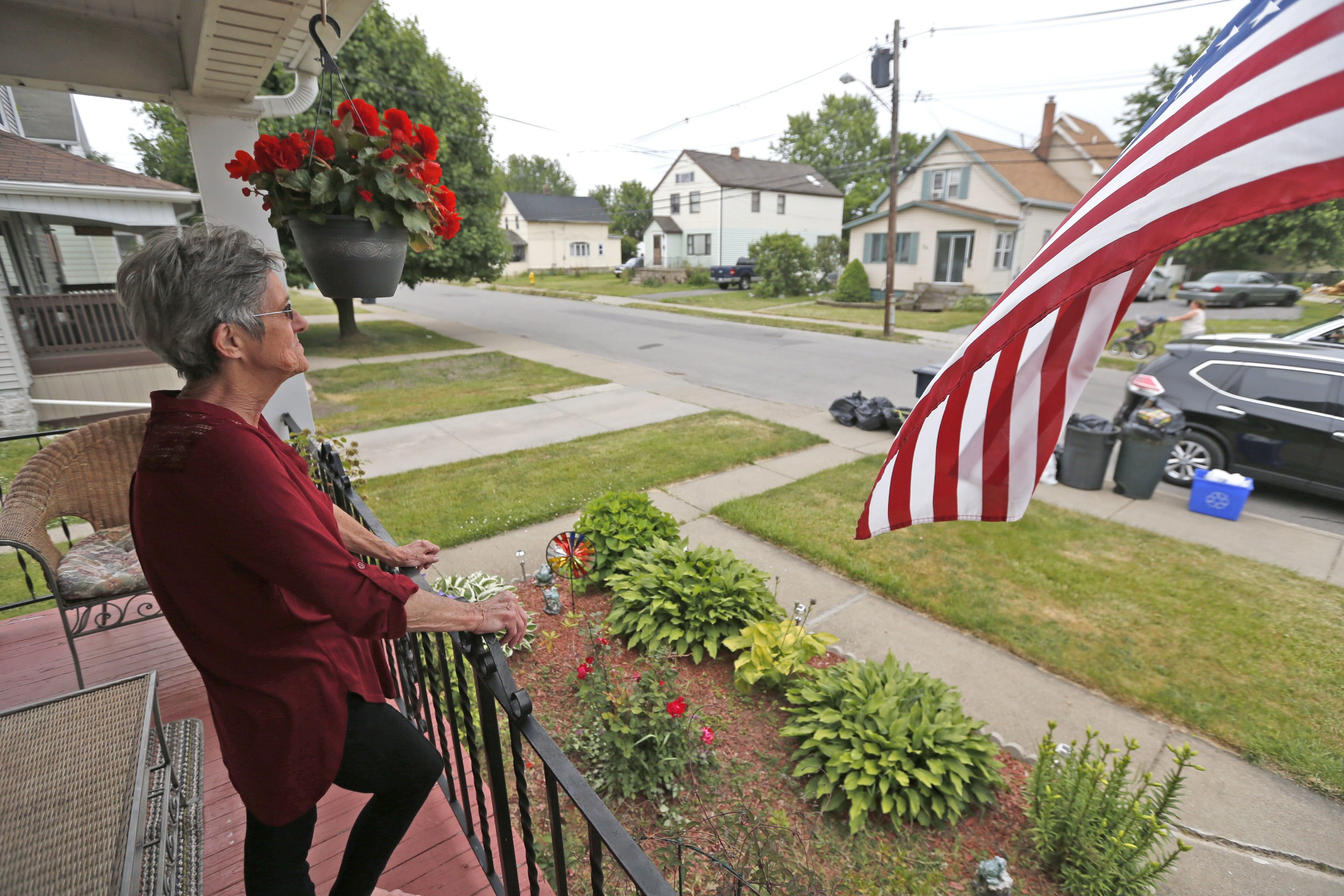 Widow Beverly Bociek watches a young couple work on the front porch of their new home on Warsaw Street in Lackawanna on Wednesday, June 15, 2016.  (Robert Kirkham/Buffalo News)