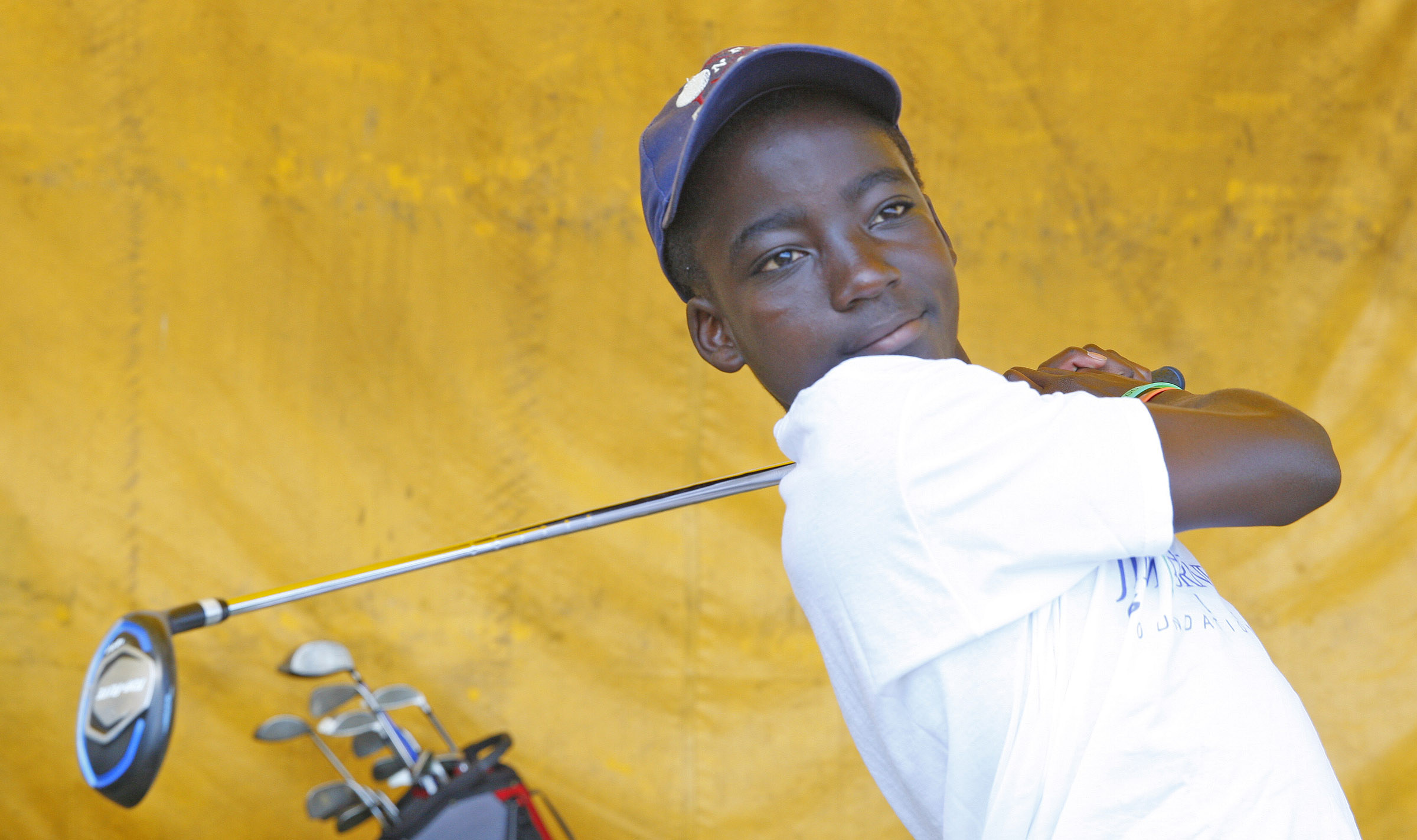 Winston Martey works on his golf game at the Jim Horne golf camp at the Airport driving range on Wednesday, Aug. 3, 2016. (Harry Scull Jr./Buffalo News)