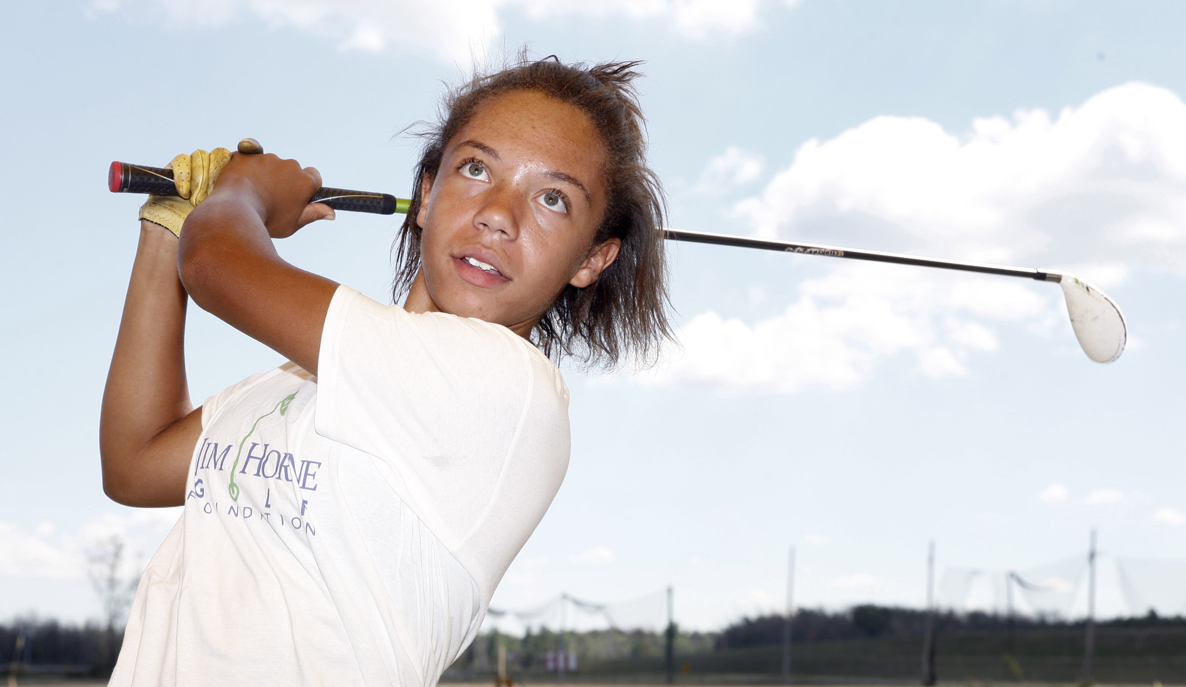 Marisa Warren works on her golf game at the Jim Horne golf camp at the Airport driving range on Wednesday, Aug. 3, 2016. (Harry Scull Jr./Buffalo News)