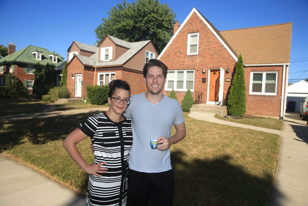 Patrick Johnson and Yelenis Rodriguez just bought their first house, on Hendricks Boulevard in Amherst. (John Hickey/Buffalo News)
