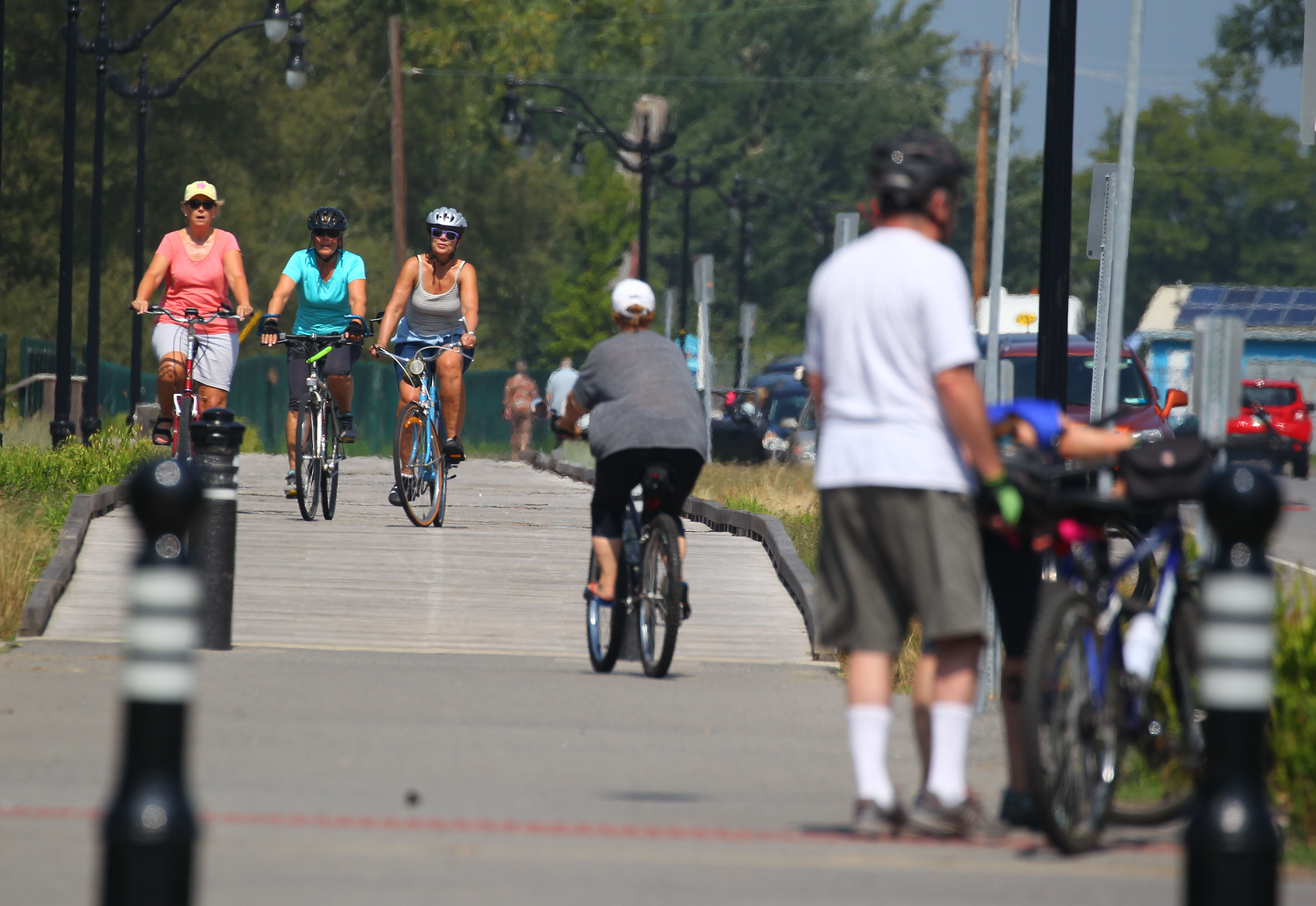 Bikers take to the paths on Furhman Blvd near Wilkeson Point. (Mark Mulville/Buffalo News)